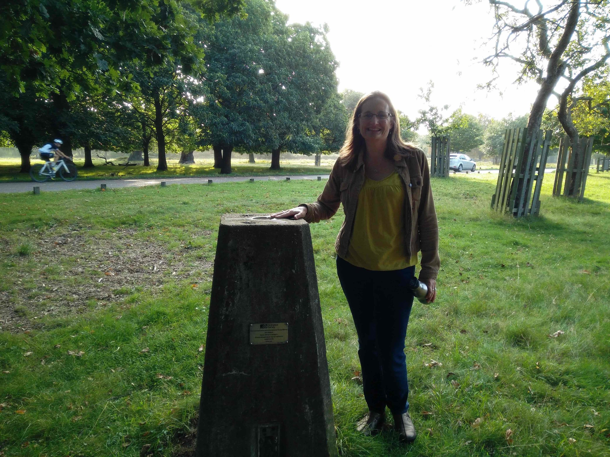 Summit meeting: Andree at the trig point in Richmond Park