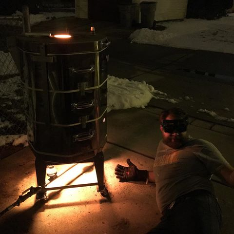 "Firing my kiln, #TinyTheTorchbearer during the winter. I think that's my ""don't these welding goggles look good on me"" pose..."