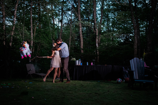 """We eloped in Jamaica on February 16, 2016. We had our """"Canadian wedding"""" that same year on August 5 in our backyard. Here's a shot taken moments after Mike sprains his wrist from breaking open a piñata with our garden shovel…"""