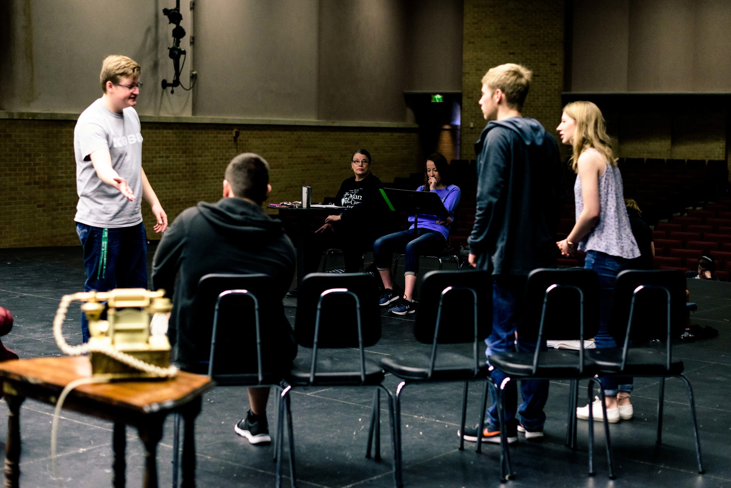 """Jacob Reed, Trace Scott, Joshua Peterson and Kaylee Hansen rehearse a scene from the upcoming play at Smoky Valley High School, """"Rest Assured."""""""