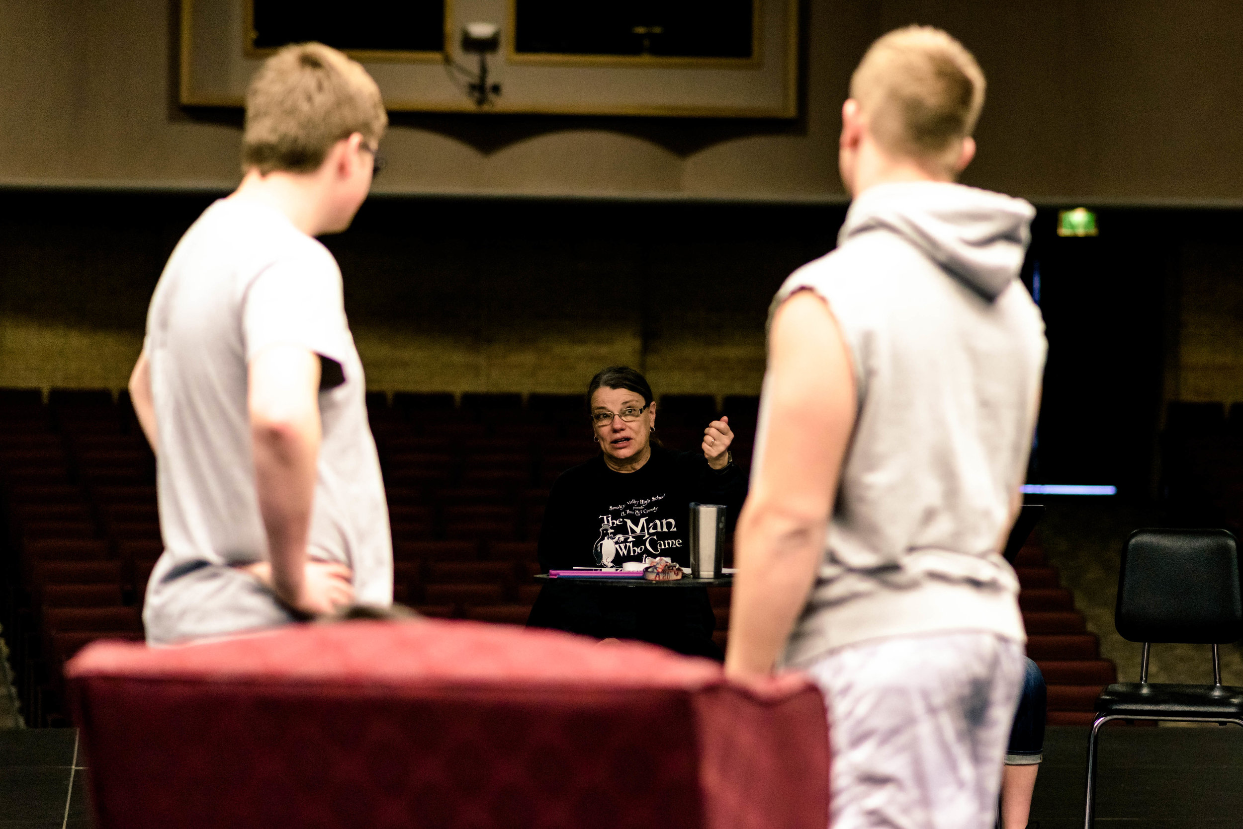 Director Lisa Christopher offers some pointers to Jacob Reed and Ethan Wampler as they fine-tune their scene.