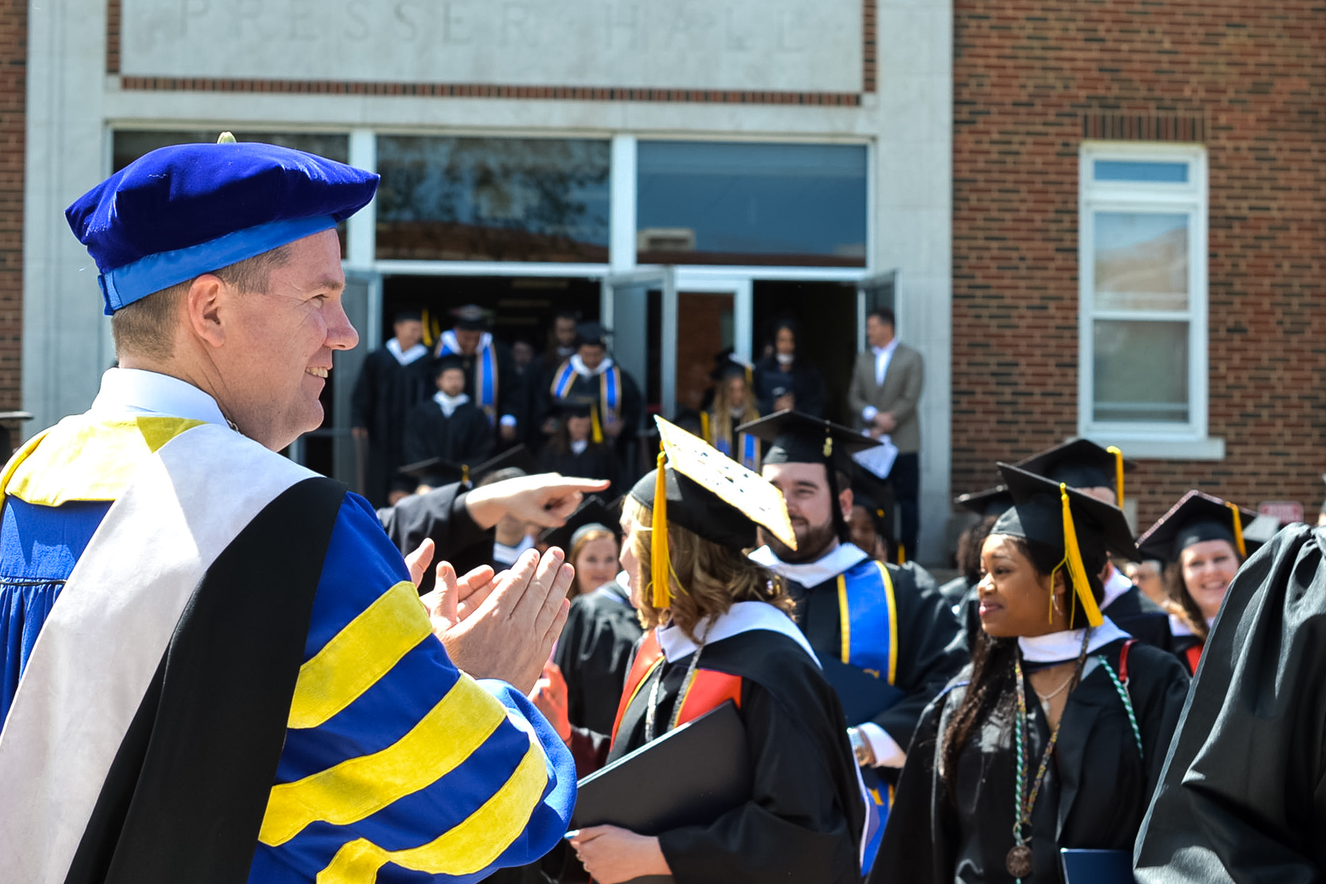 Bethany College President Will Jones greets the graduates from the Class of 2019 outside Presser Hall Auditorium following Sunday's commencement ceremony.