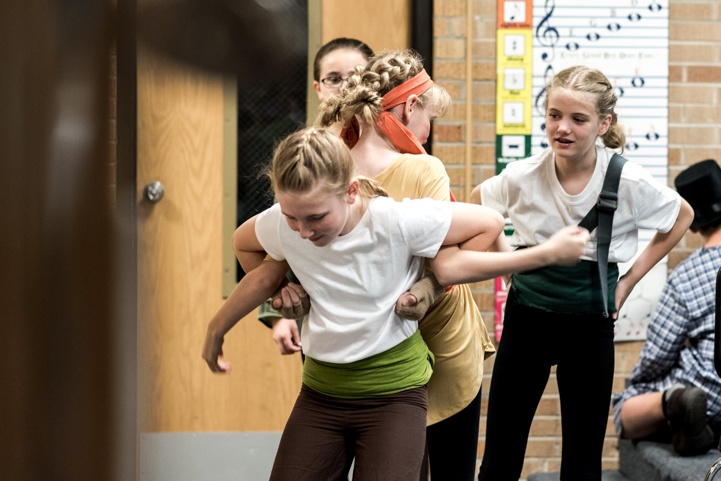 Erin Dolezal (foreground) and sisters - Esther and Echo Clark tighten up a tricky dance move before the curtain goes up.
