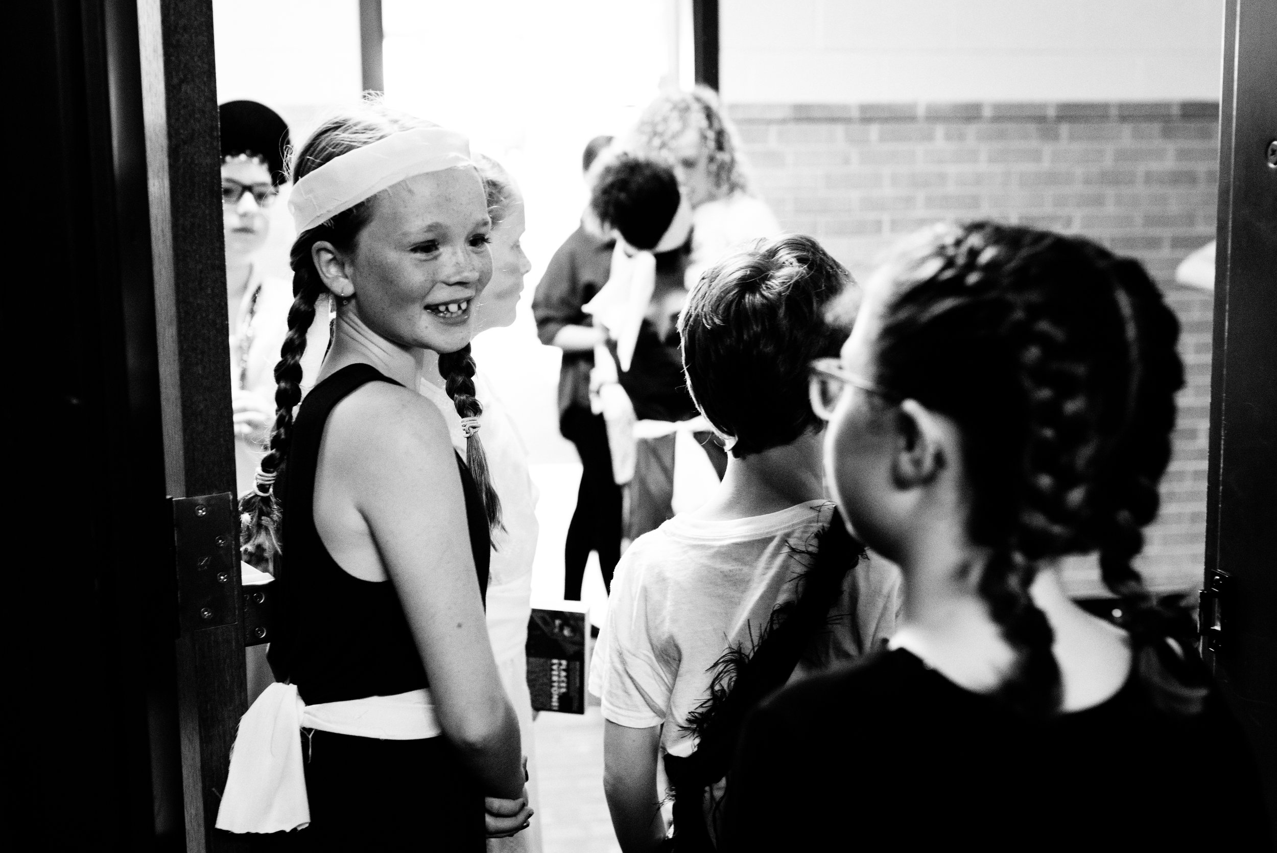 Jersey Elseth flashes a smile to her Brave Girl cast members before they hit the stage.
