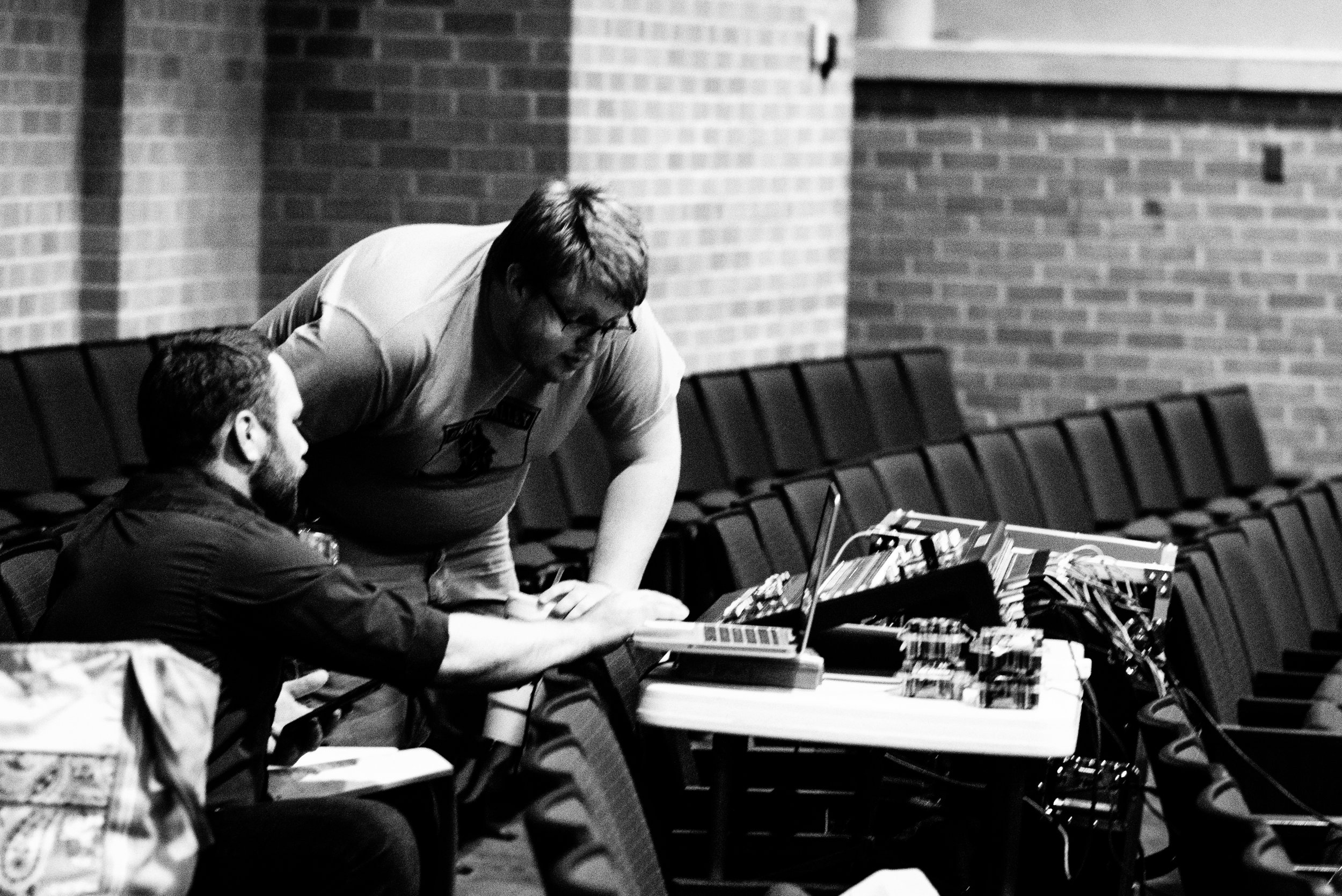 """""""Sounds good!"""" Adam Lackey (seated) and Tyler Breneman work out the final sound check levels before the seats are filled."""