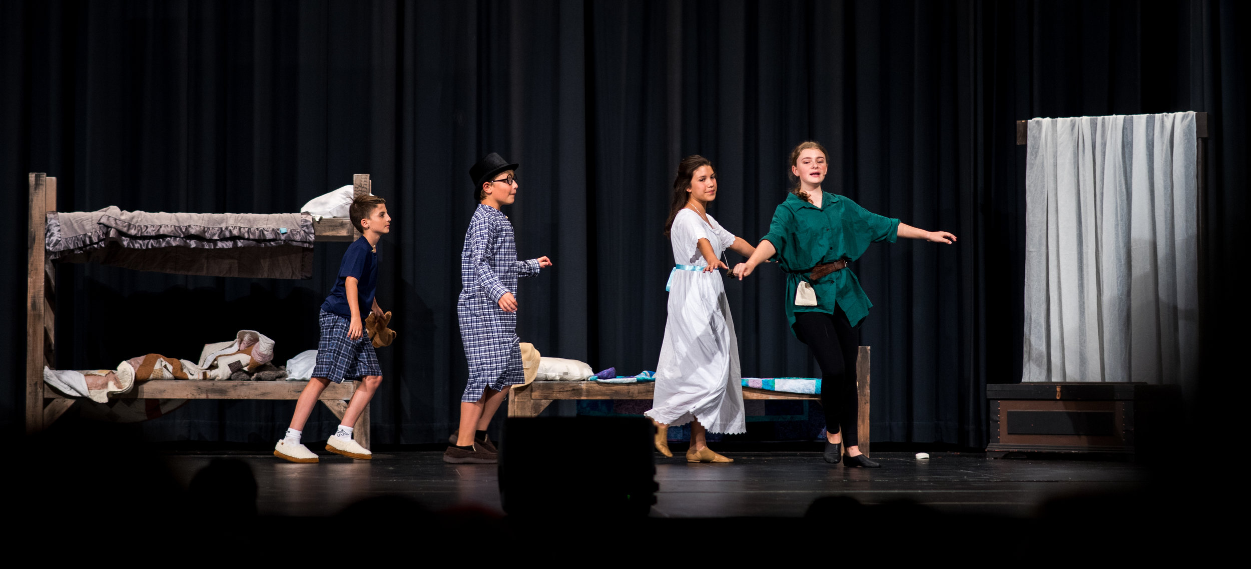 On the cover: from left Jackson Martin (Michael) Nicholas Dreier (John) Helena Lundberg (Wendy) follow Peter Pan played by Lauren Dolezal into flight and off to Neverland.