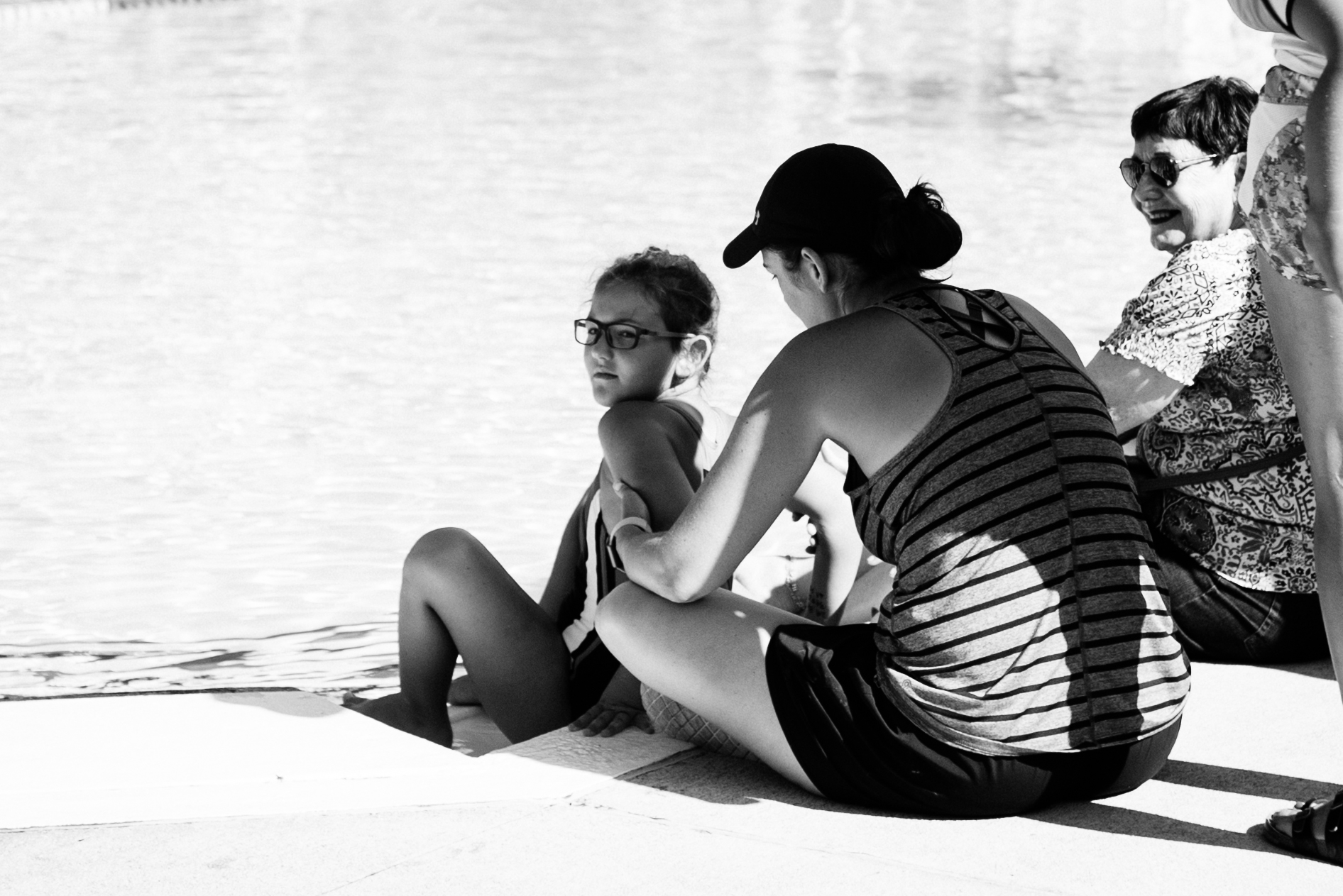 Water's Edge. Caroline King and her mom Morgan King soak in the day.