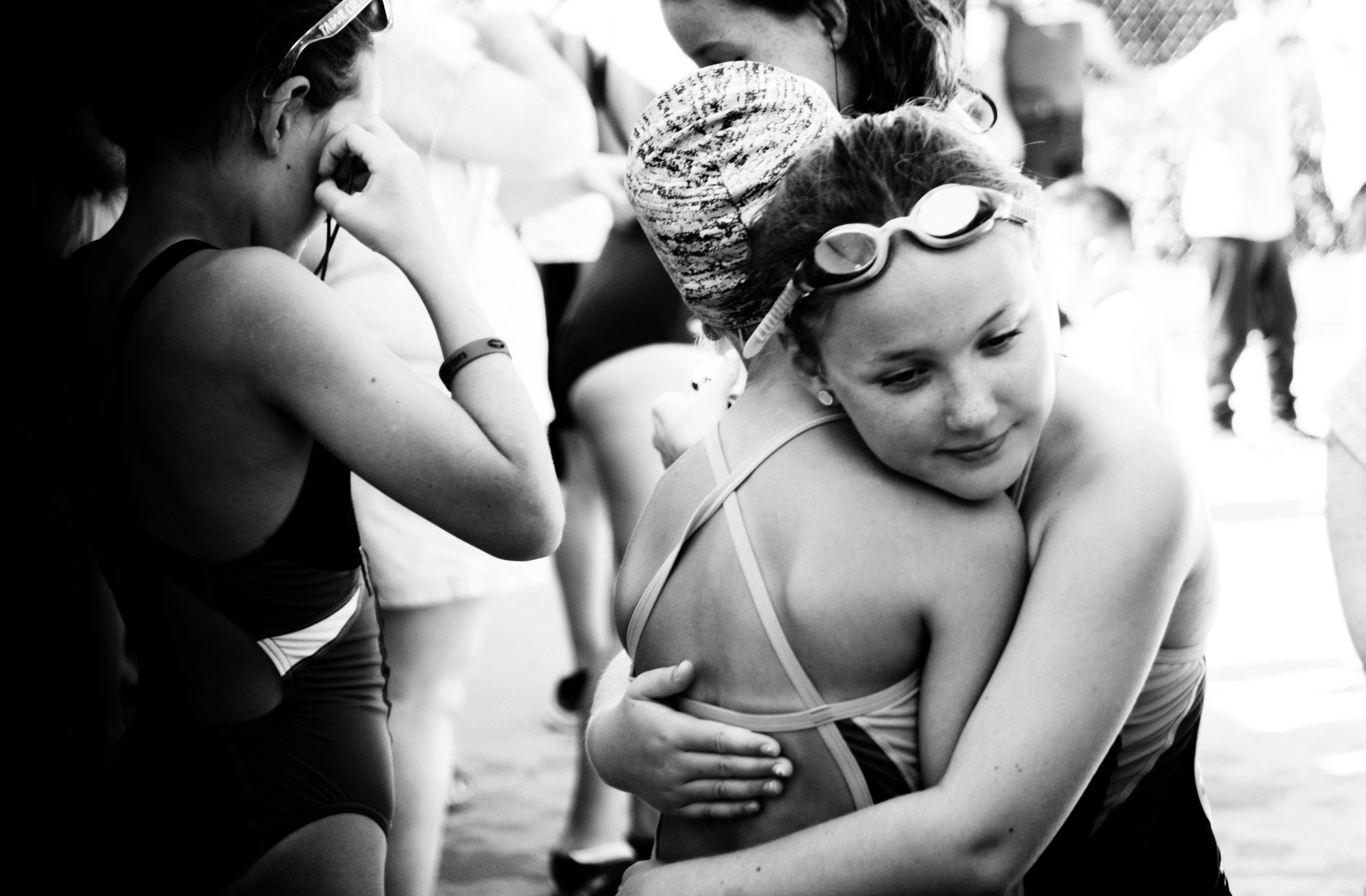 Hugs, encouragement and family time are always part of the recipe for a Wavemakers' swim meet.