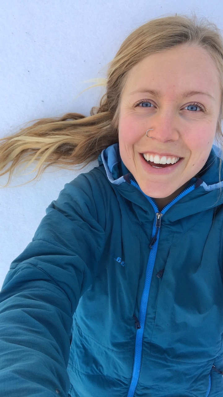 laying in the snow post wintery trail run