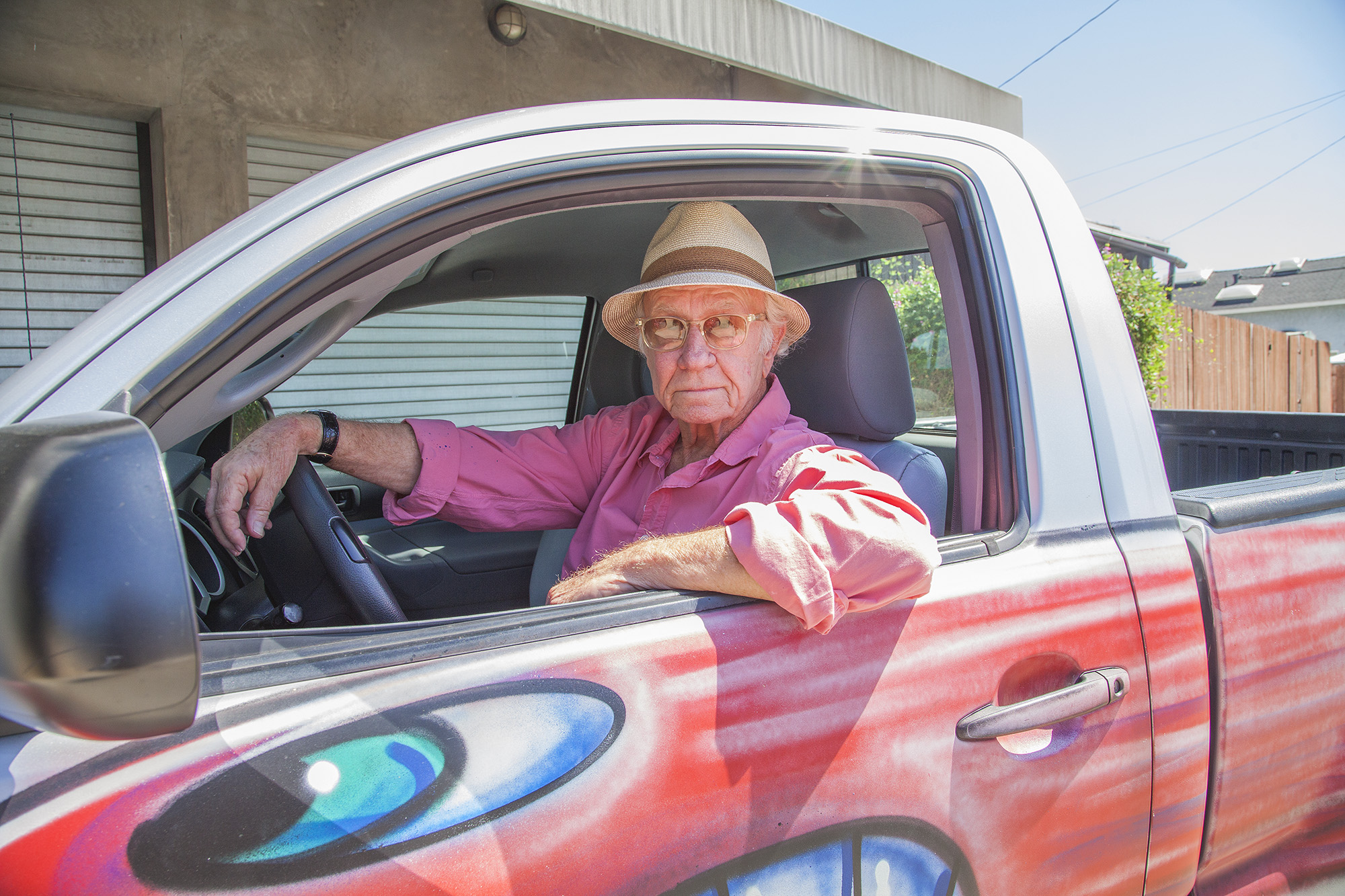 Joe in pick up truck painted by Kenny Scharf (2015)