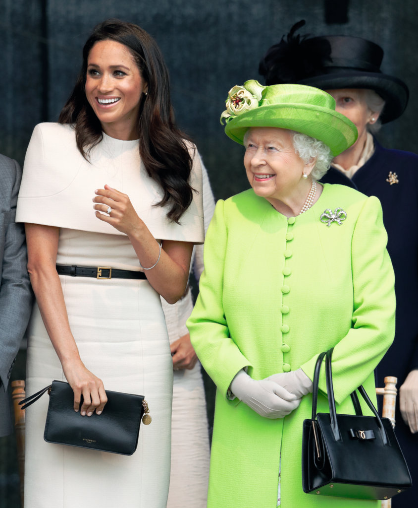 The Duchess of Sussex accompanies the Queen on their first joint engagement in June 2018.