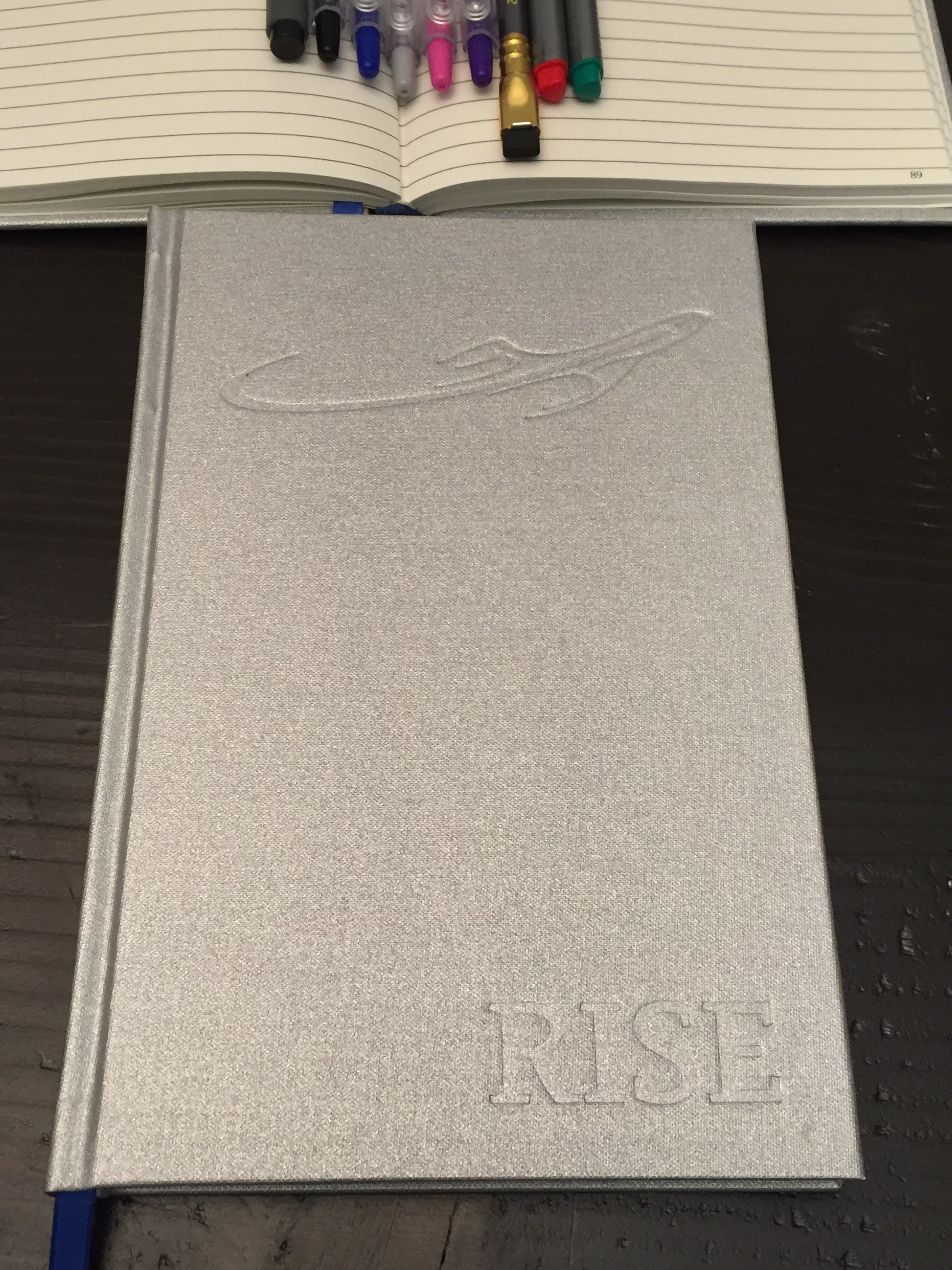Exterior Cover of  Rise , the notebook for people who are going places. Hardcover ruled notebooks offer a premium writing experience without the use of a flat, hard surface.