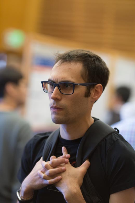 Luke at one of the 2017 Genome Informatics meeting's poster sessions.