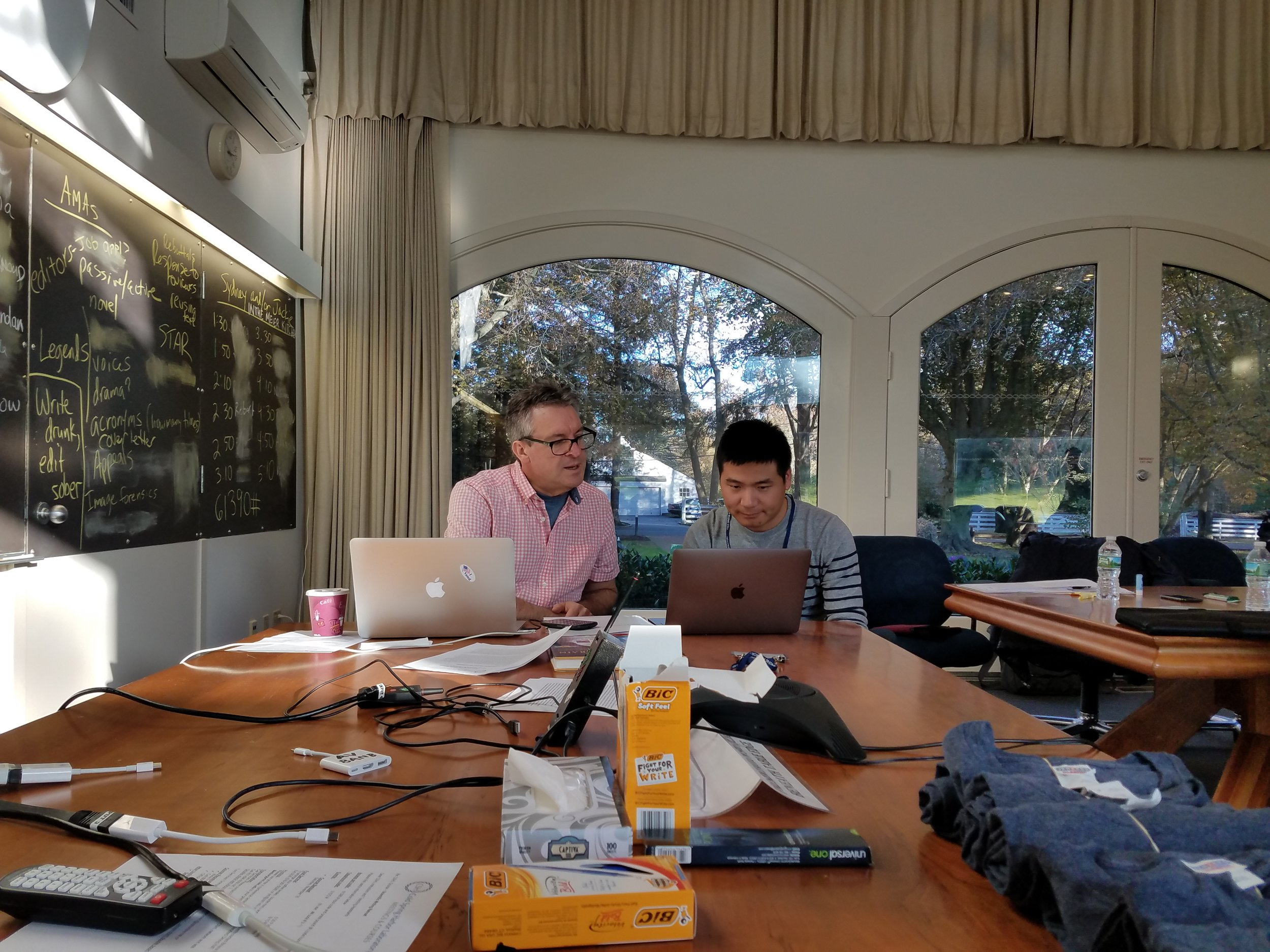Scientific Writing Retreat Co-Instructor Stephen Matheson working one-on-one with a 2017 course trainee in the Conference Center.