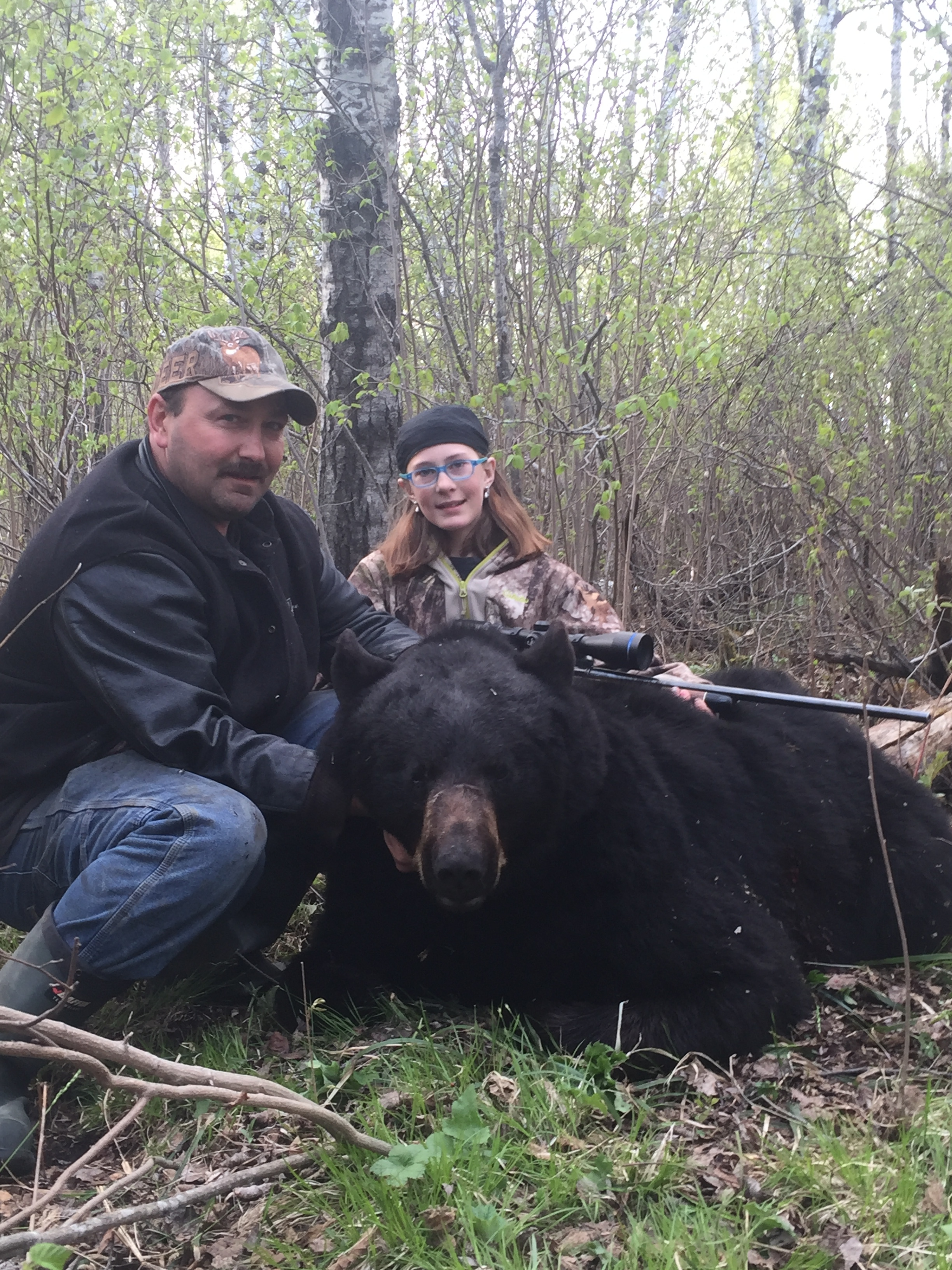 Richard and daughter pose with bear after a sucsessful hunt.