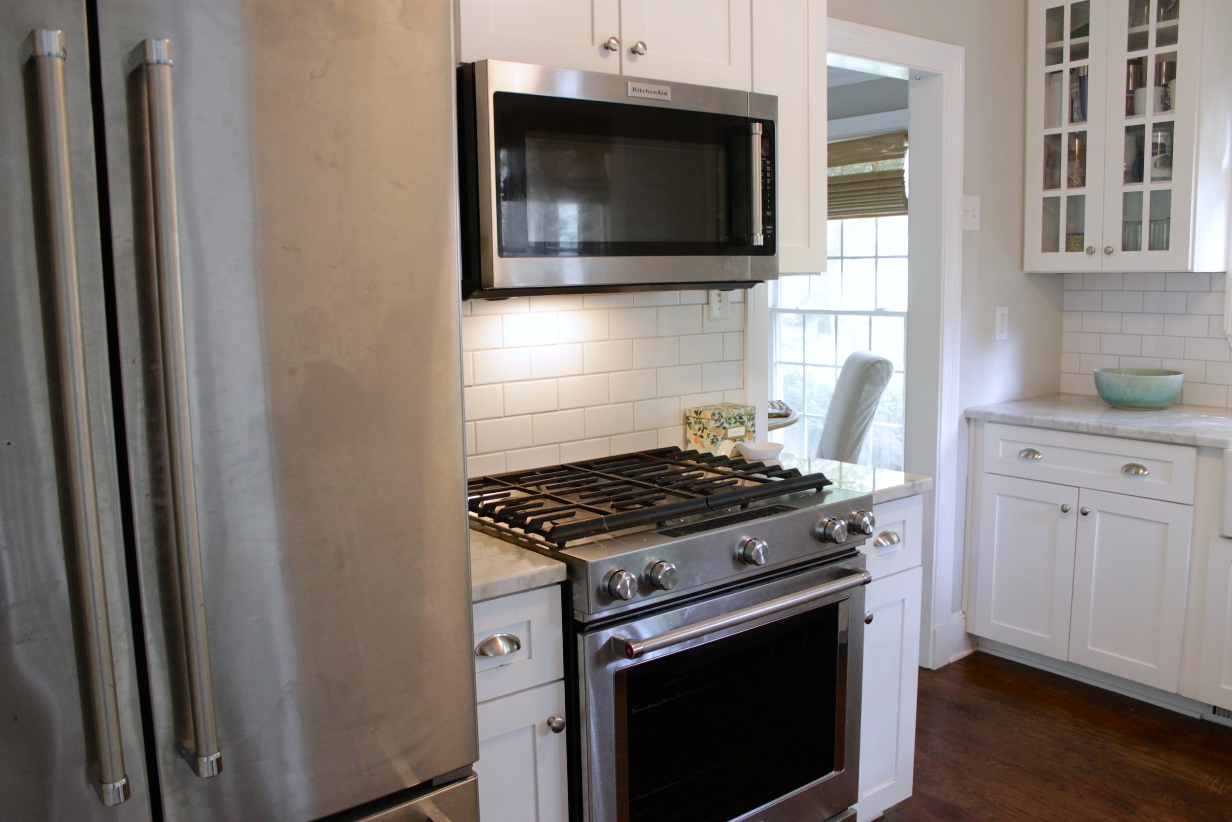 Prime Design Memphis, LLC - Small White Kitchen, Marble Countertops, and Subway Tile Backlash