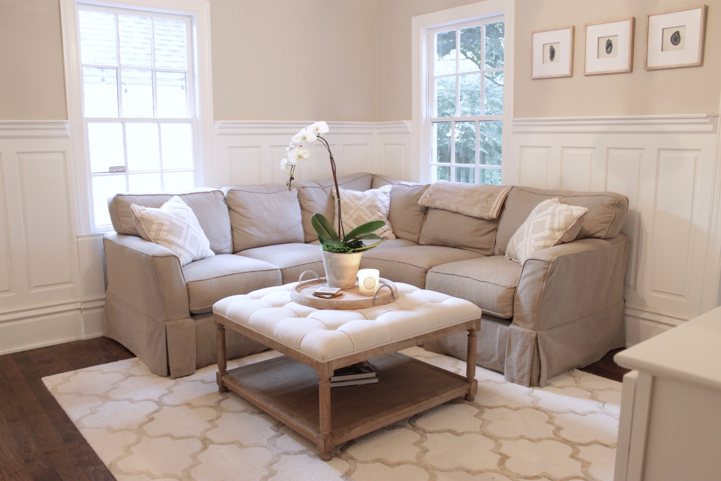 Prime Design Memphis, LLC - Family Room, Agreeable Gray, White Wainscoting, Sectional, Neutral, Orchid, Tufted Ottoman, Built-in