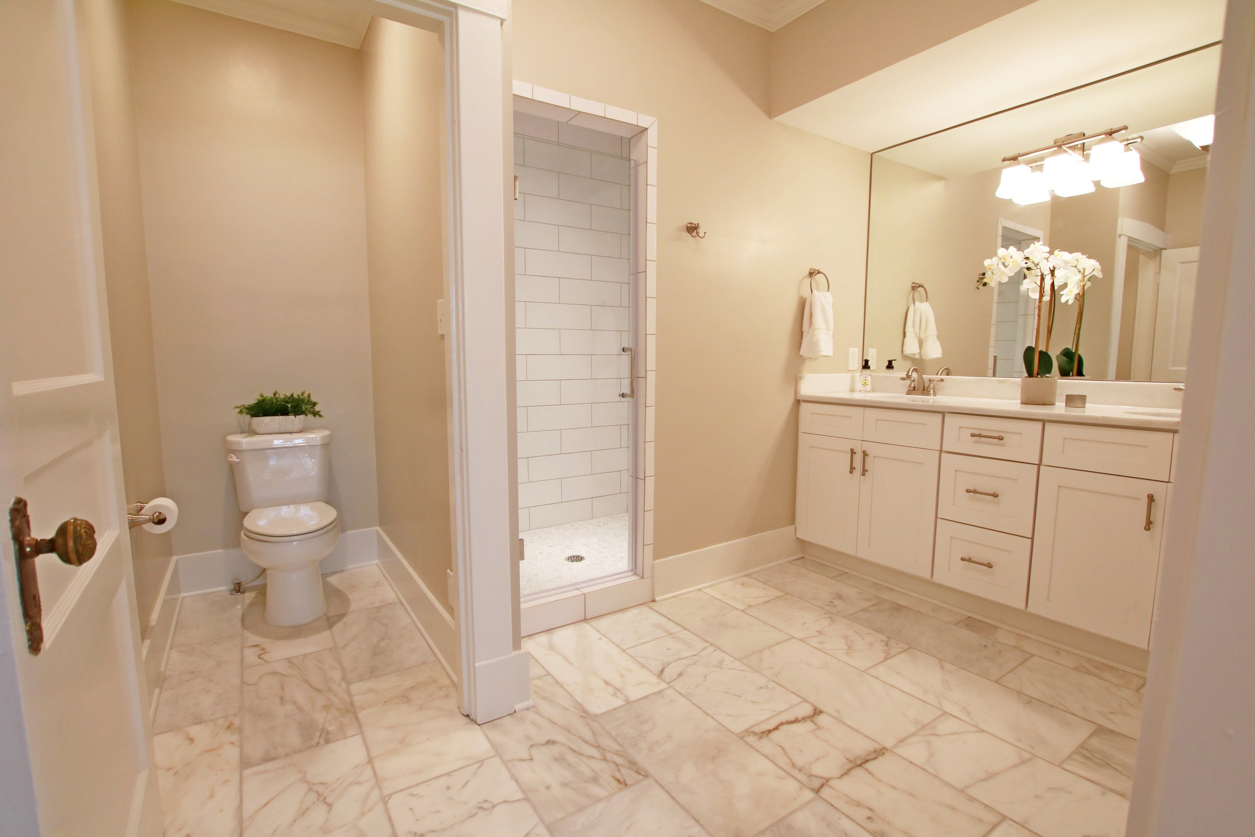 Prime Design Memphis, LLC - Master Bathroom, Carrara Marble Tile and Countertops, Subway Tile, White Shaker Double Vanity