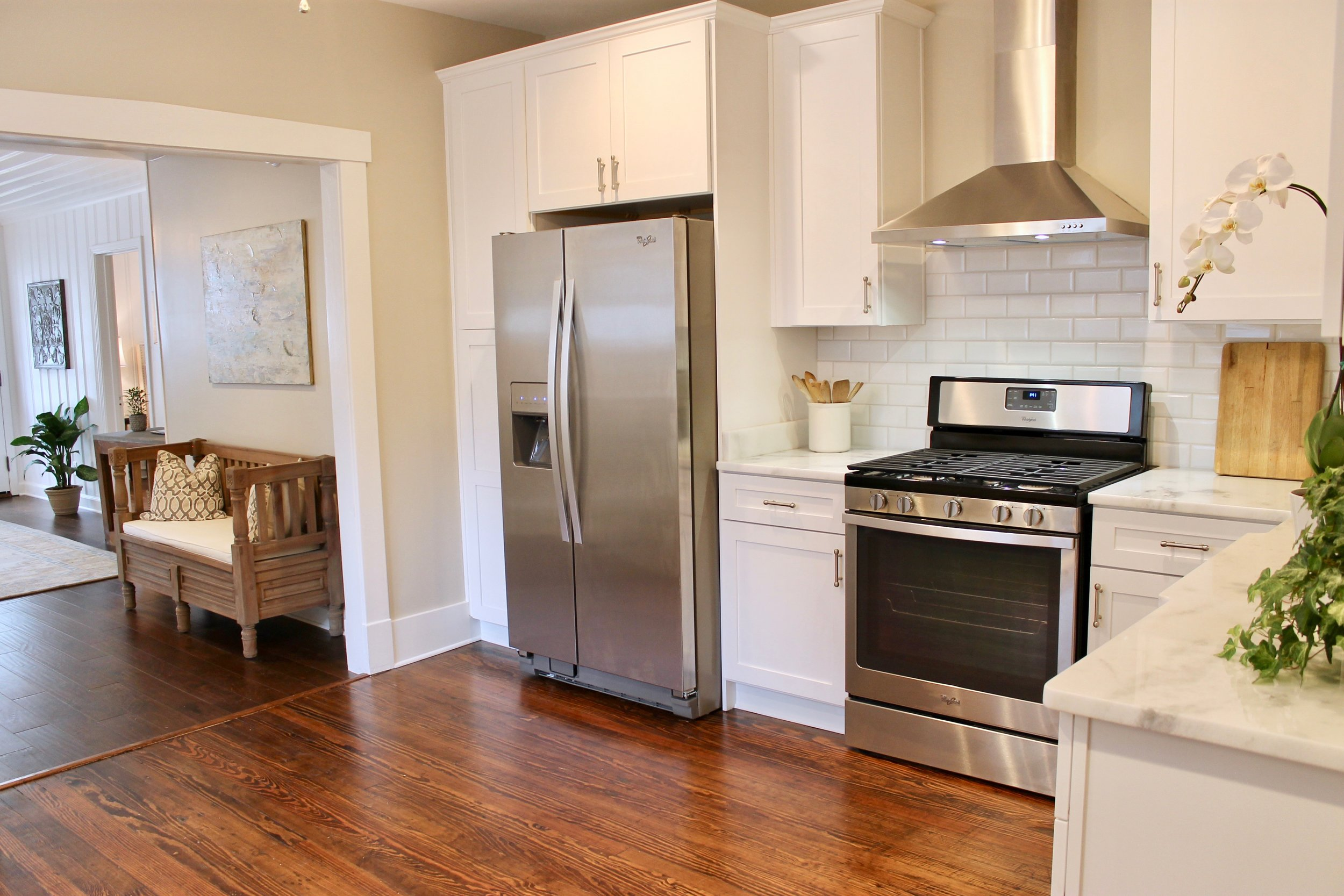 Prime Design Memphis, LLC - White kitchen, beveled subway tiles, shaker cabinets, hardwood floors