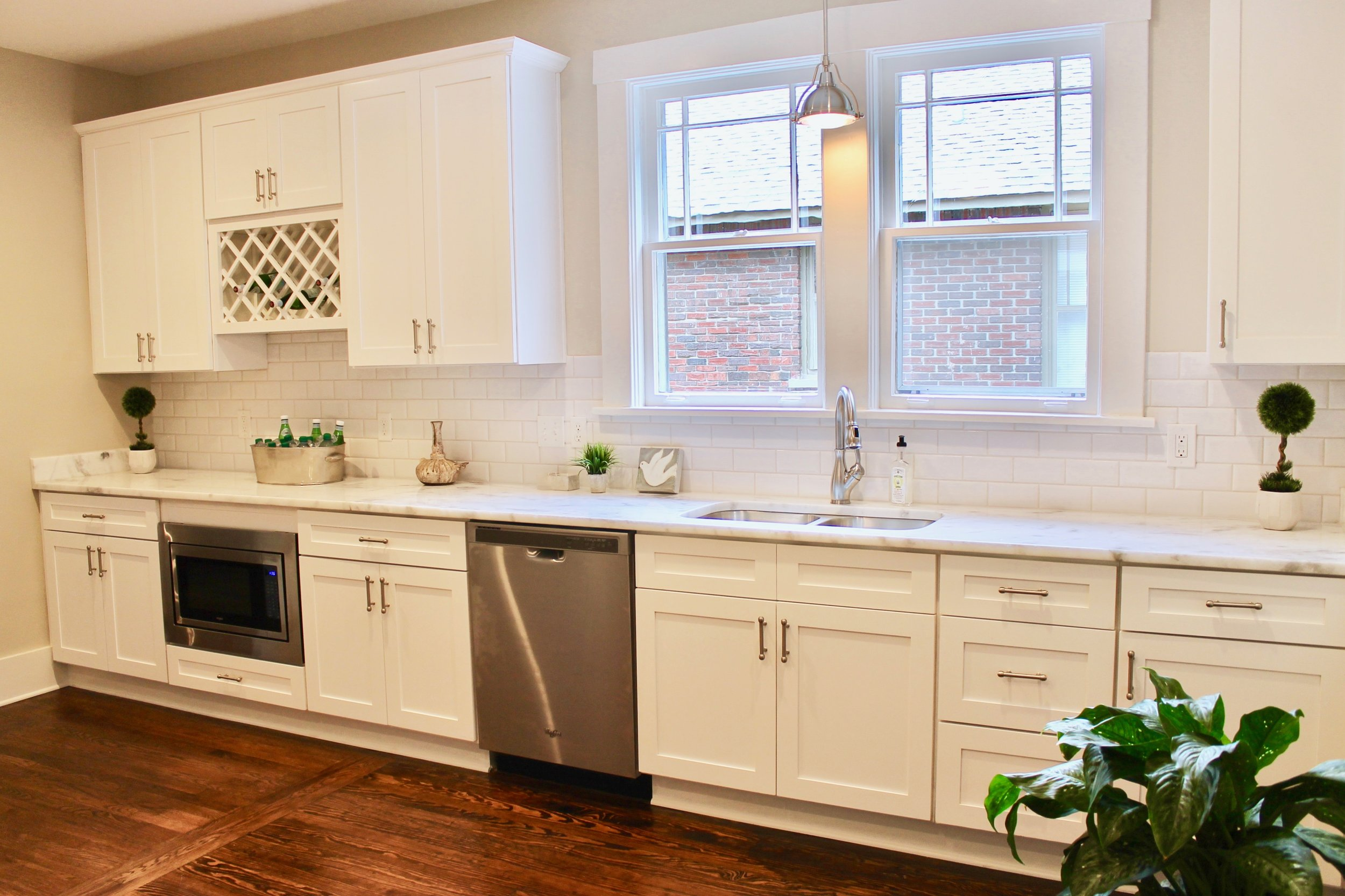Prime Design Memphis, LLC - White kitchen, beveled subway tiles, shaker cabinets, hardwood floors, wine rack