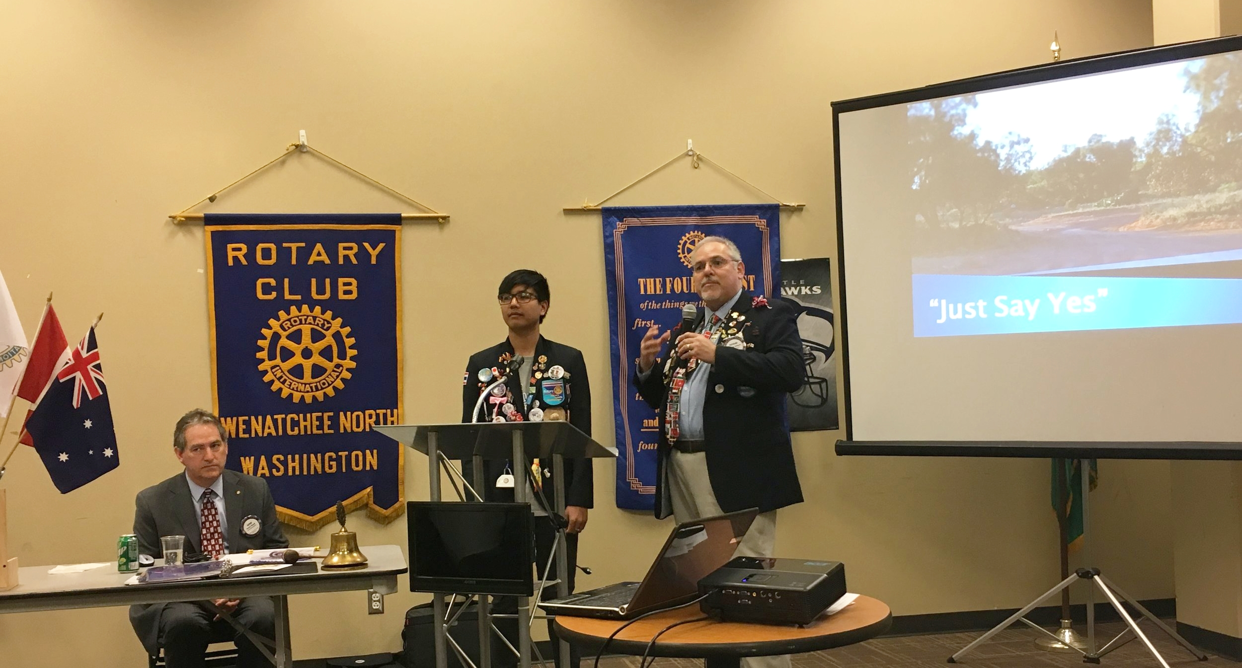 President elect Richard DeRock introduces Rotary exchange student Putter, from Thailand