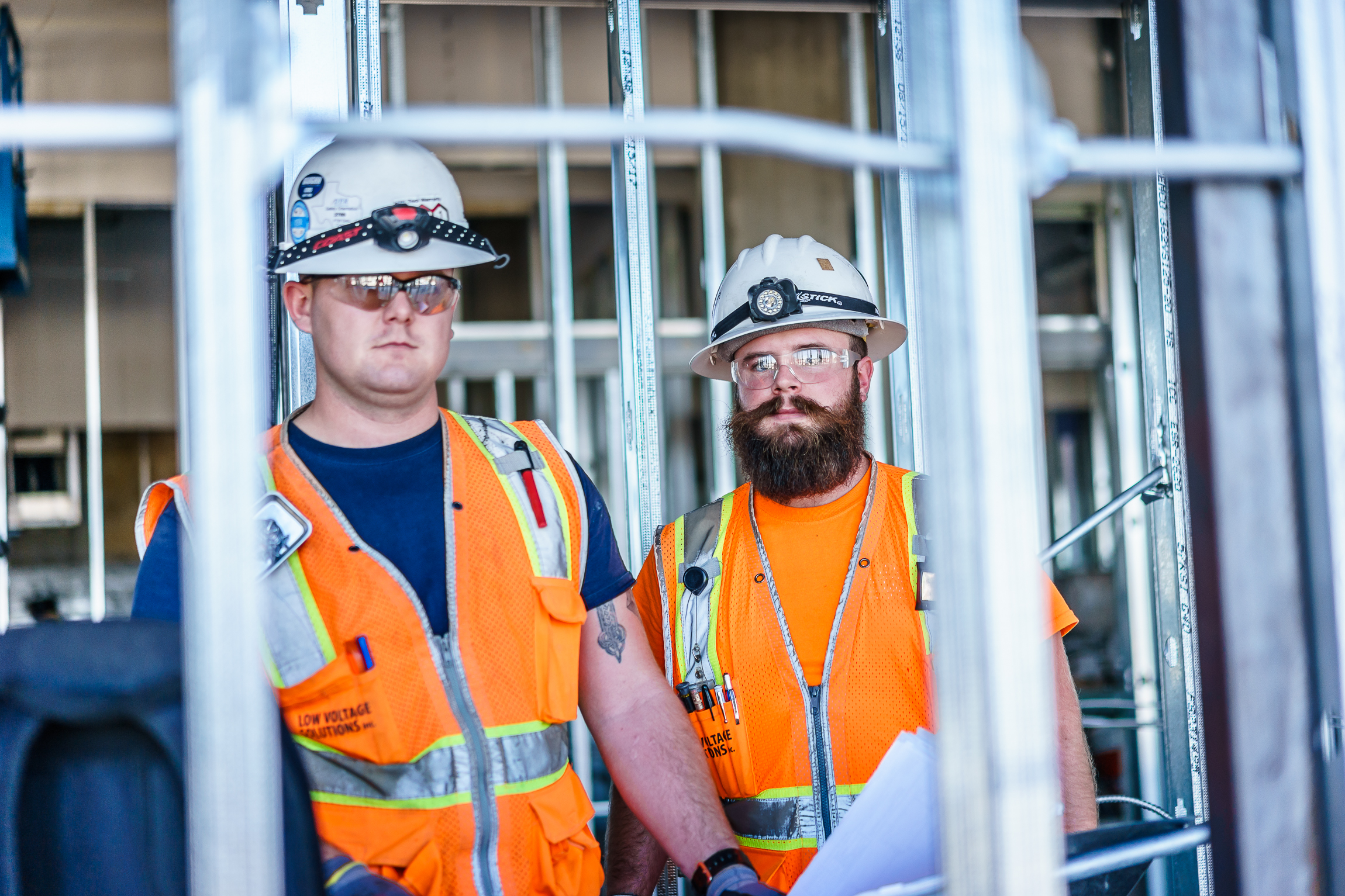 Two Low Voltage Solutions employees smile for the camera