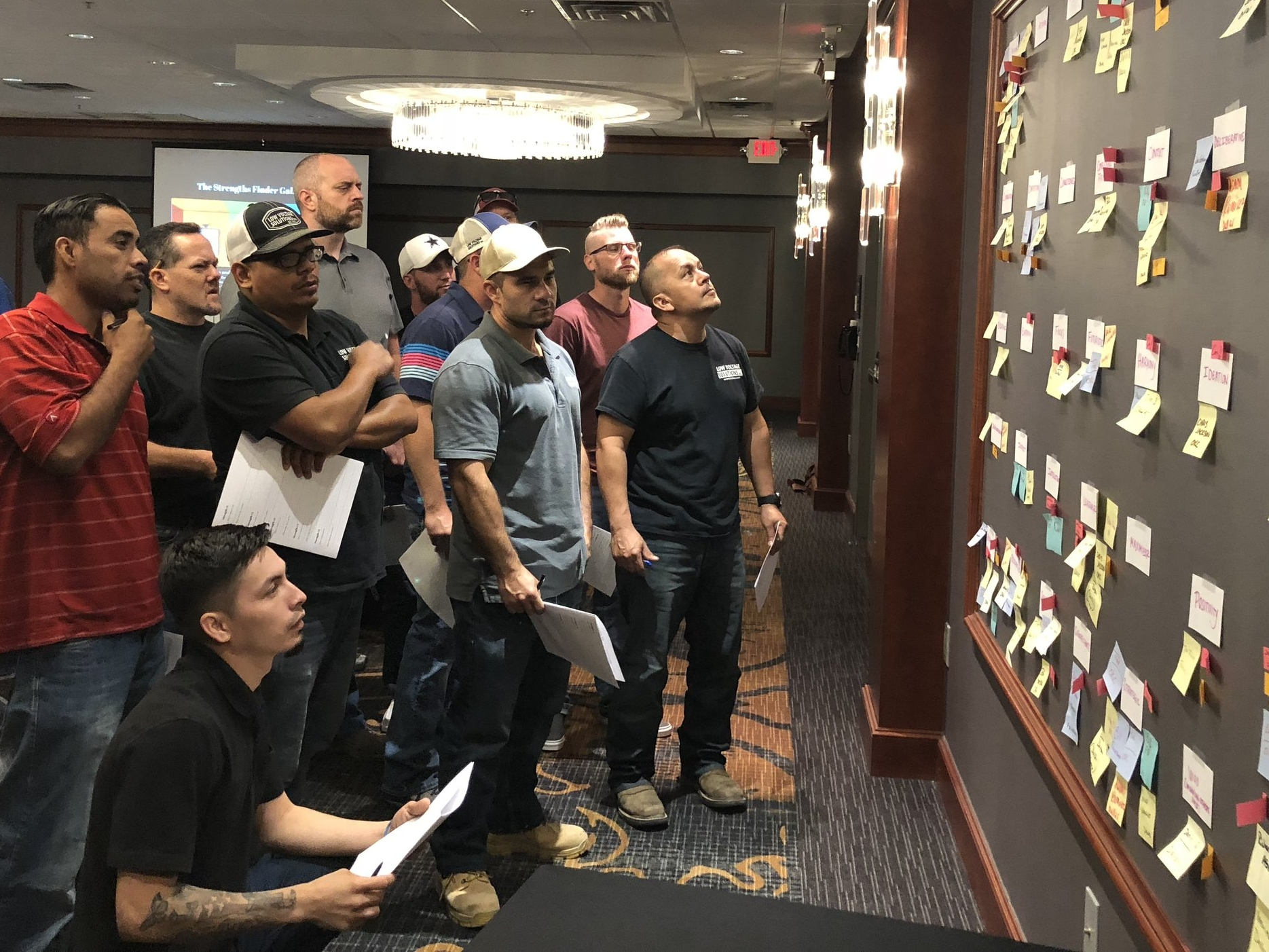Low Voltage Solutions employees look at a wall of content from their leadership training session.