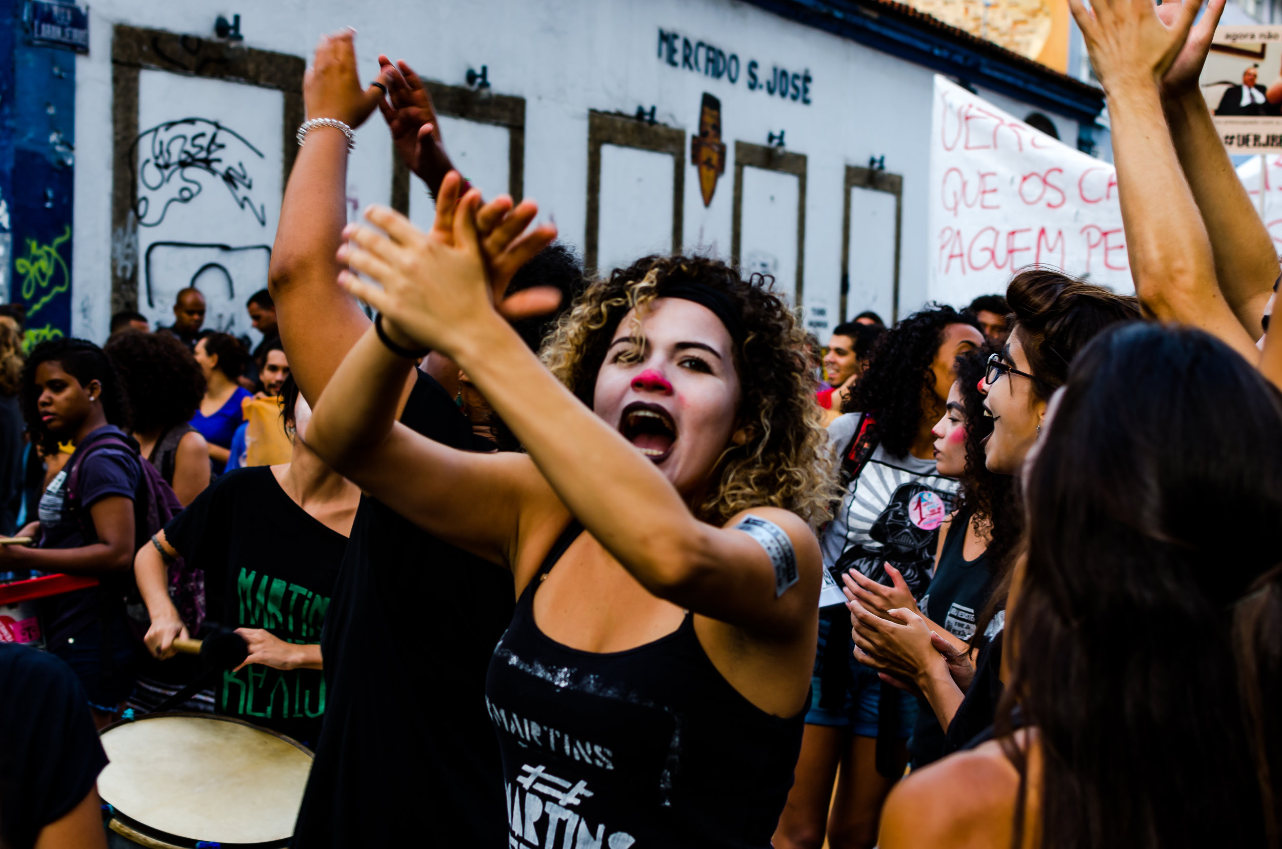 Protesters from a Rio De Janeiro arts school sing and dance during a demonstration aimed at voicing concerns over the lack of funding that has plagued the post-secondary education system since the recession has started.