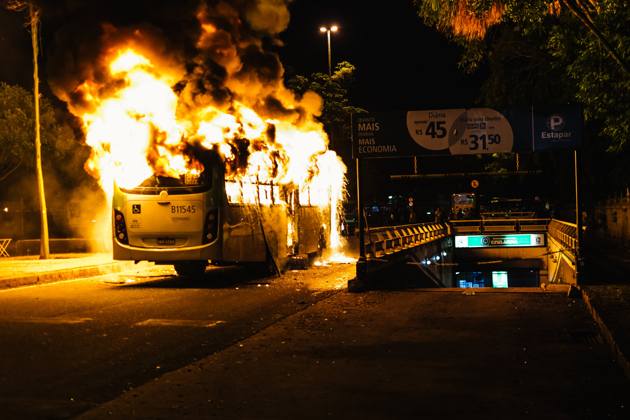A bus burns after being set on fire by Anti-Temer protesters. President Michael Temer's government suffers from an incredibly low approval rating, principally stemming from his pro-business policies and a long running corruption scandal that threatens to topple the second president in as many years.