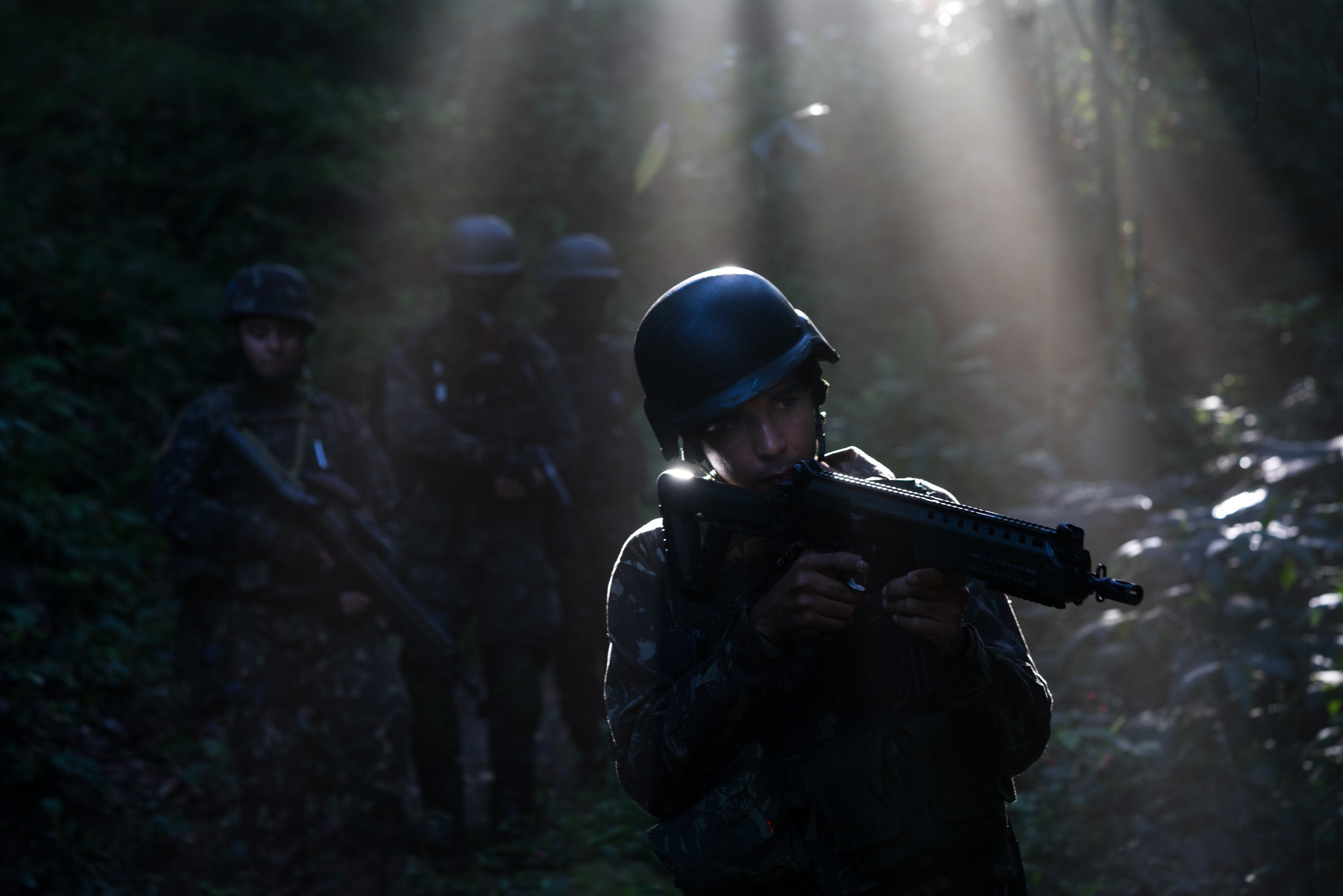 Brazilian Soldiers Search Rio's Jungles for Drug traffickers and weapons stashes.