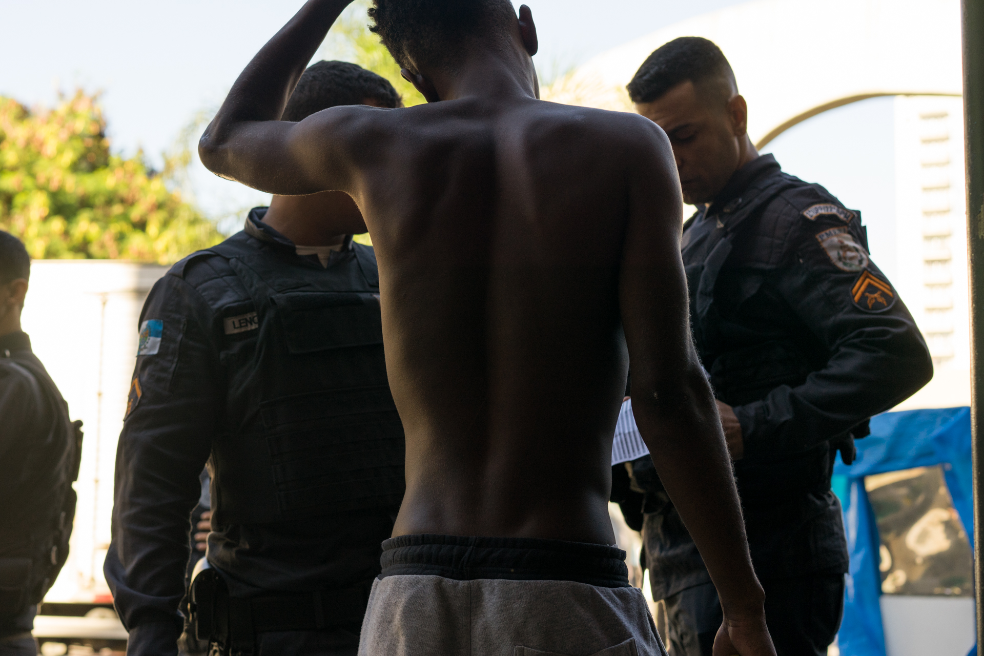 Police question a young man after he is unable to provide identification, Saturday, March 24, 2018, in Rio de Janeiro.