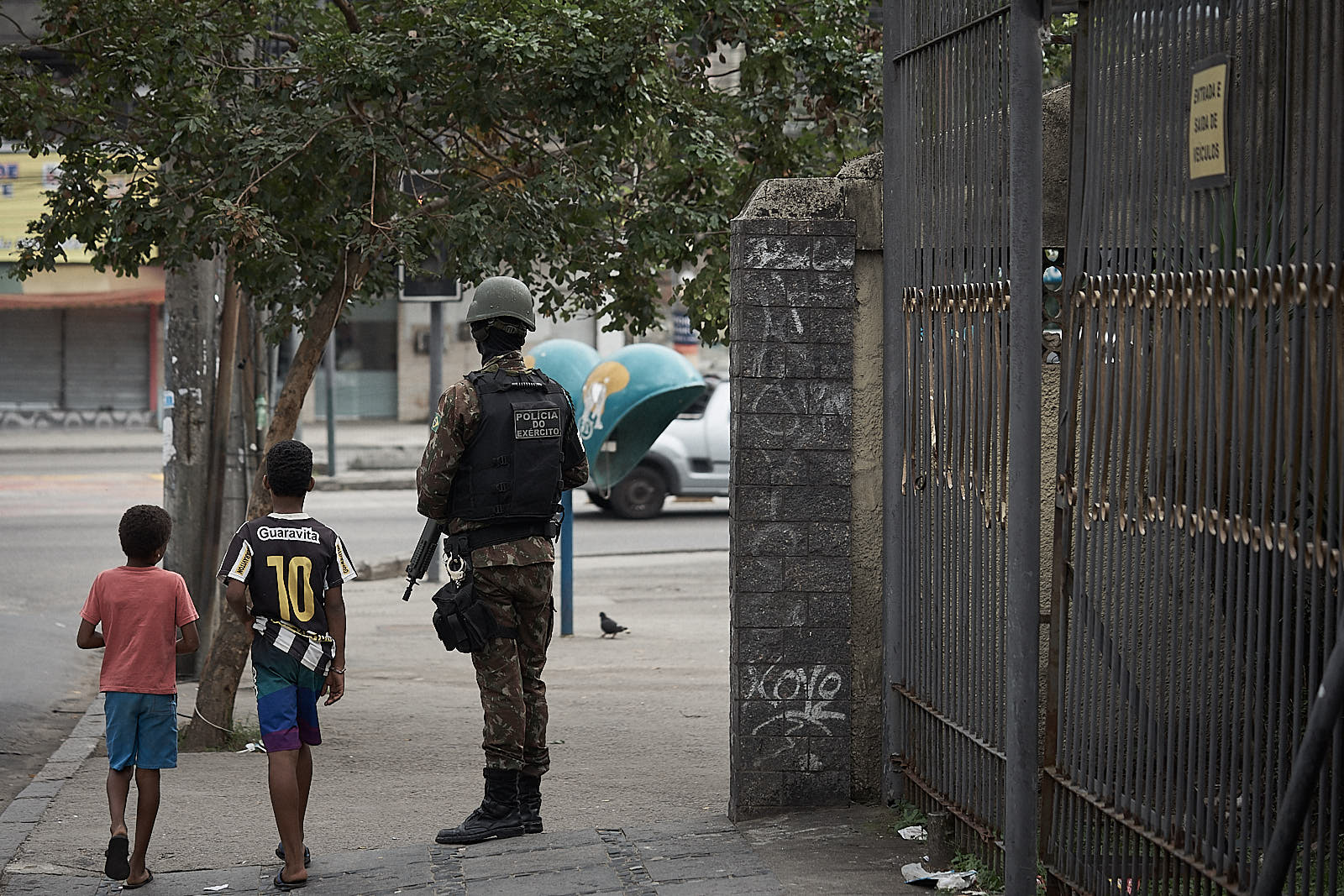 A Brazilian soldier, part of the federal intervention, guards a street during an operation against narcotics factions. The government says that policy decisions like these operations are what has caused a recent drop in crime. (Photo: C.H. Gardiner)