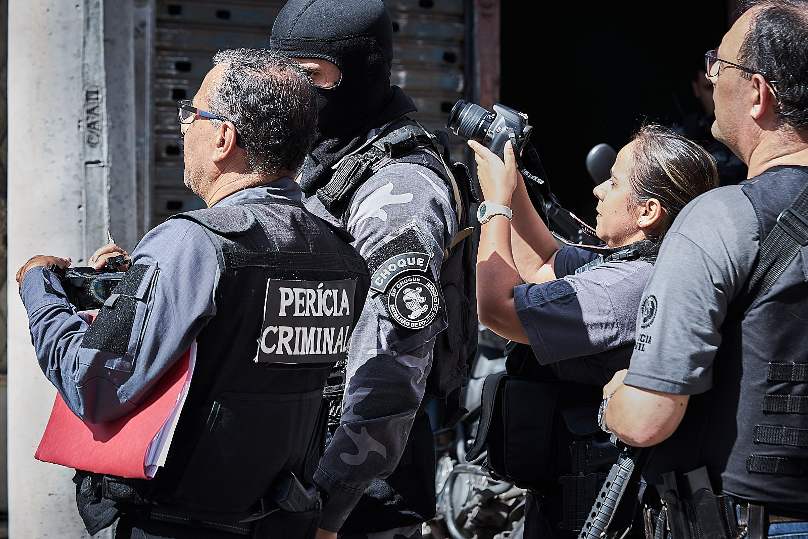 A member of Rio's Choque battalion guides investigators through the events that happened leading up to the killing of nine alleged traffickers in a house in Rio de Janeiro. (Photo C.H. Gardiner)