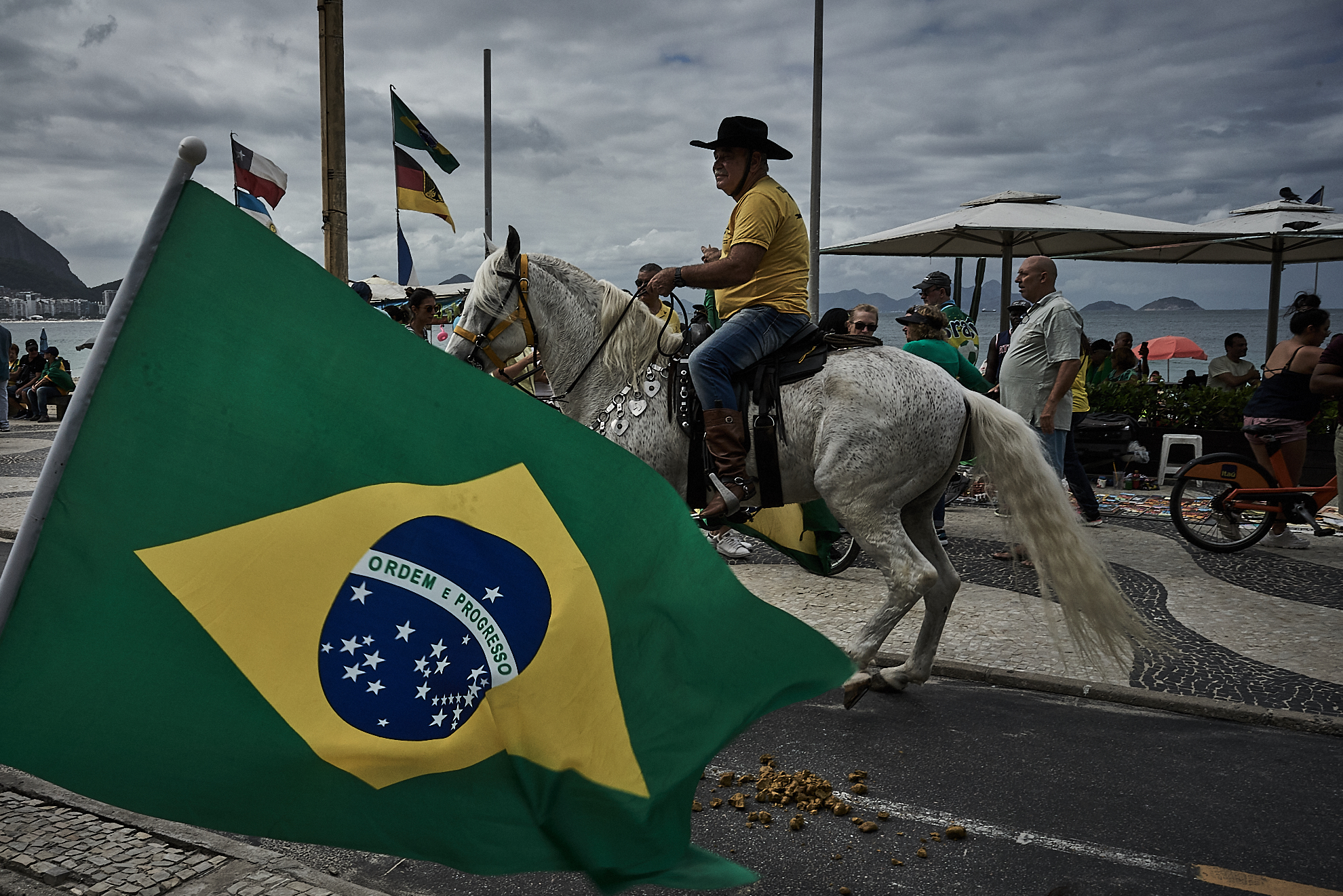 A demonstrator rides a horse on Copacabana beach during an act in support of Brazil's President Jair Bolsonaro (Photo: C.H. Gardiner)
