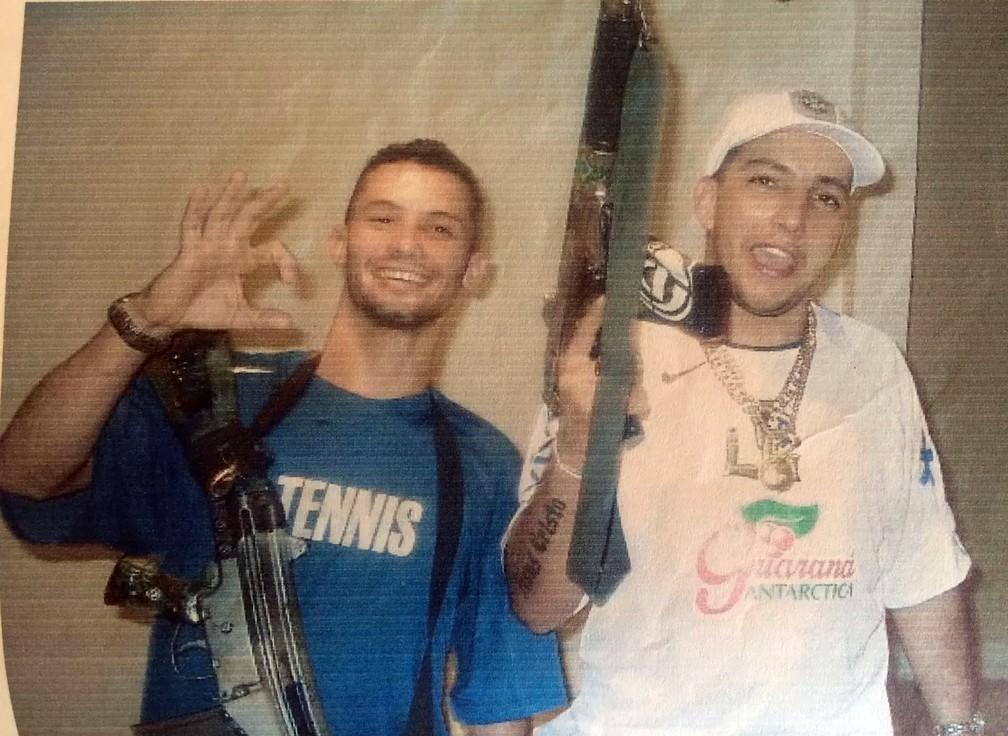 Fernando Gomes de Freitas, right, holds a firearm in a photo taken prior to his death (Photo: Social Media)
