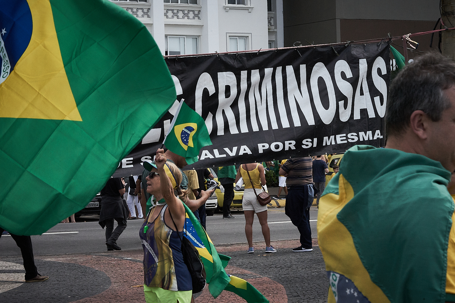 Pro-Bolsonaro supporters wave flags and show banners during a demonstration (Photo: C.H. Gardiner)