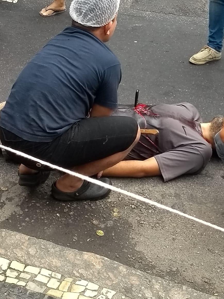 Edivaldo Ribeiro de Farias lays in the street after stabbing himself Thursday. (Photo: Social Media)