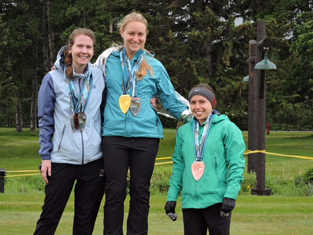 Laura Kromann on the podium in Glacier National Park