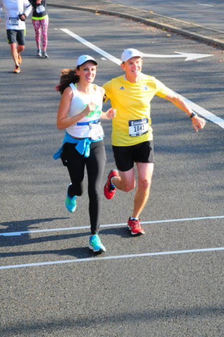 Meghan running with Murphy, CIM 2016