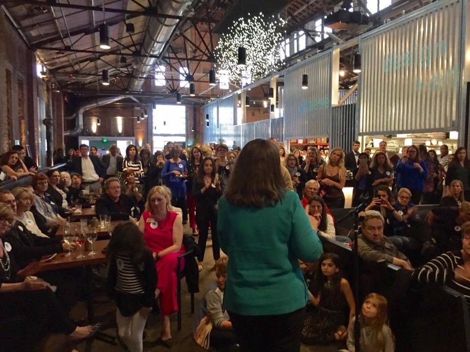 Congresswoman Diana DeGette speaking to Blue Rising Supporters in Denver.