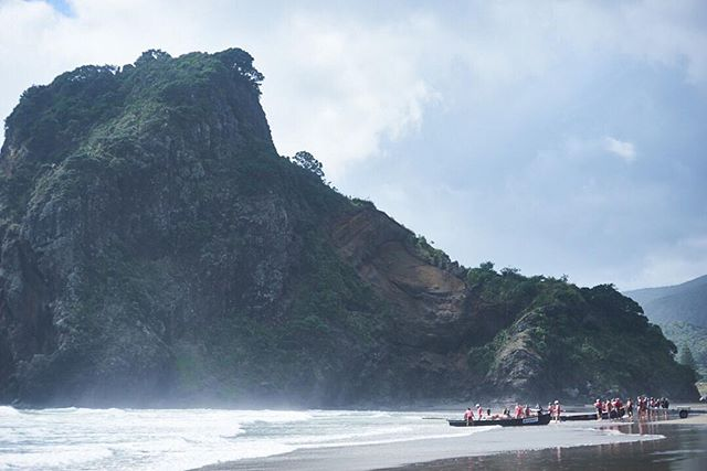 """""""Day of Giants"""" is a big wave rowing event, hosted by Piha's Surf Life Saving club every year.  Here, the rowing teams prepare to enter the surf beside the iconic Lion Rock.  #dayofgiants2017 #surflifesavingnewzealand #surflifesaving #piha #lionrock #auckland #newzealand #surf #rowing #bigwaverowing #rowing #sport"""
