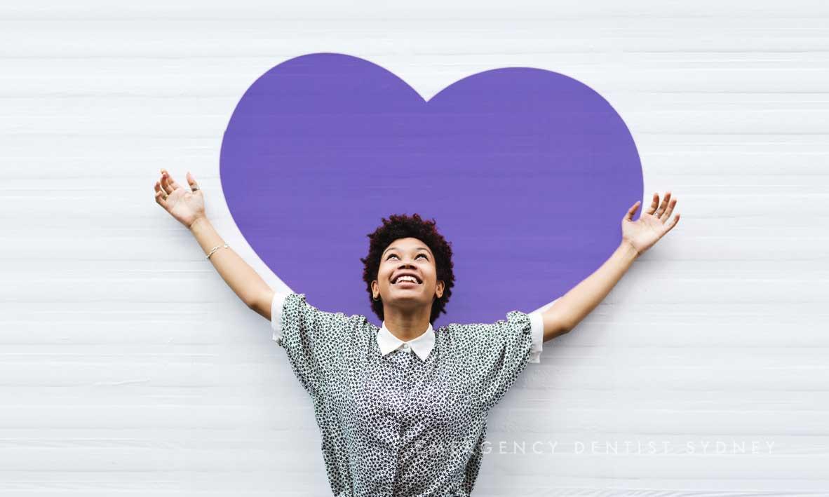© Paramount Dental Sydney Easy Ways To Improve Your Dental Health in 2018 02 Girl Smiling Loveheart 2.jpg
