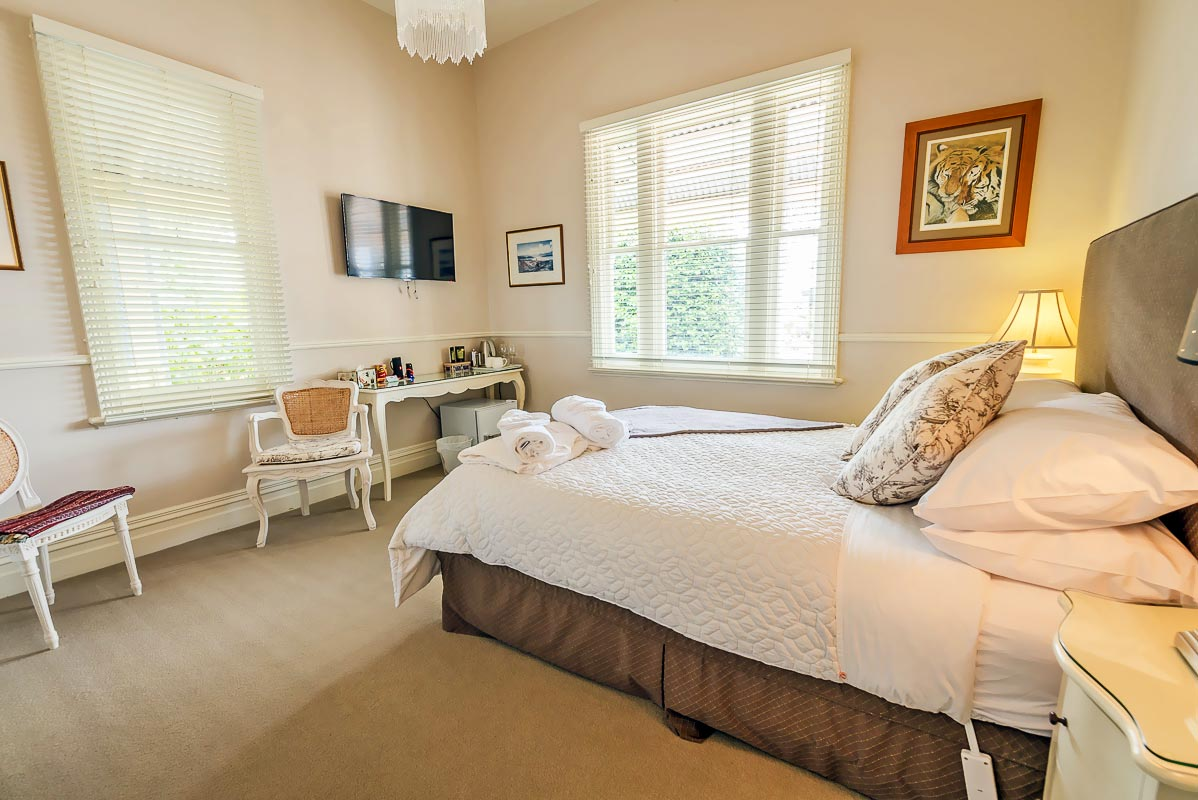 Brown Room - The other original large bedroom with a great view over the front garden...