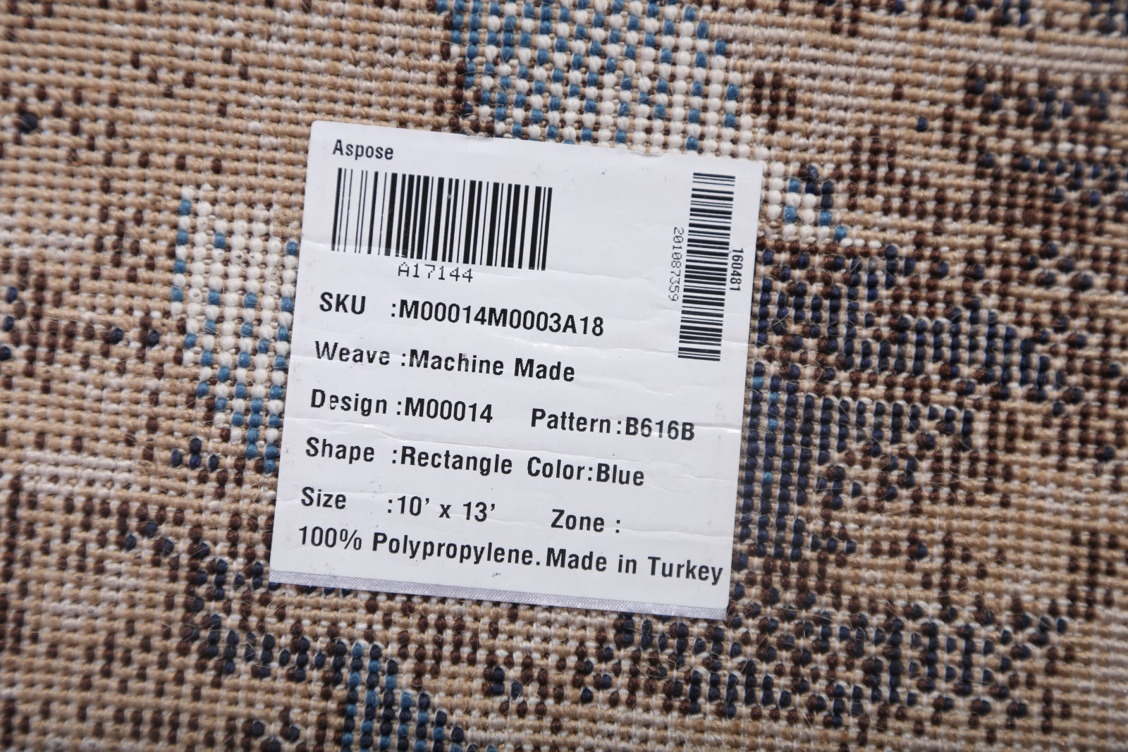 Rug tag indicating country of origin and weave.