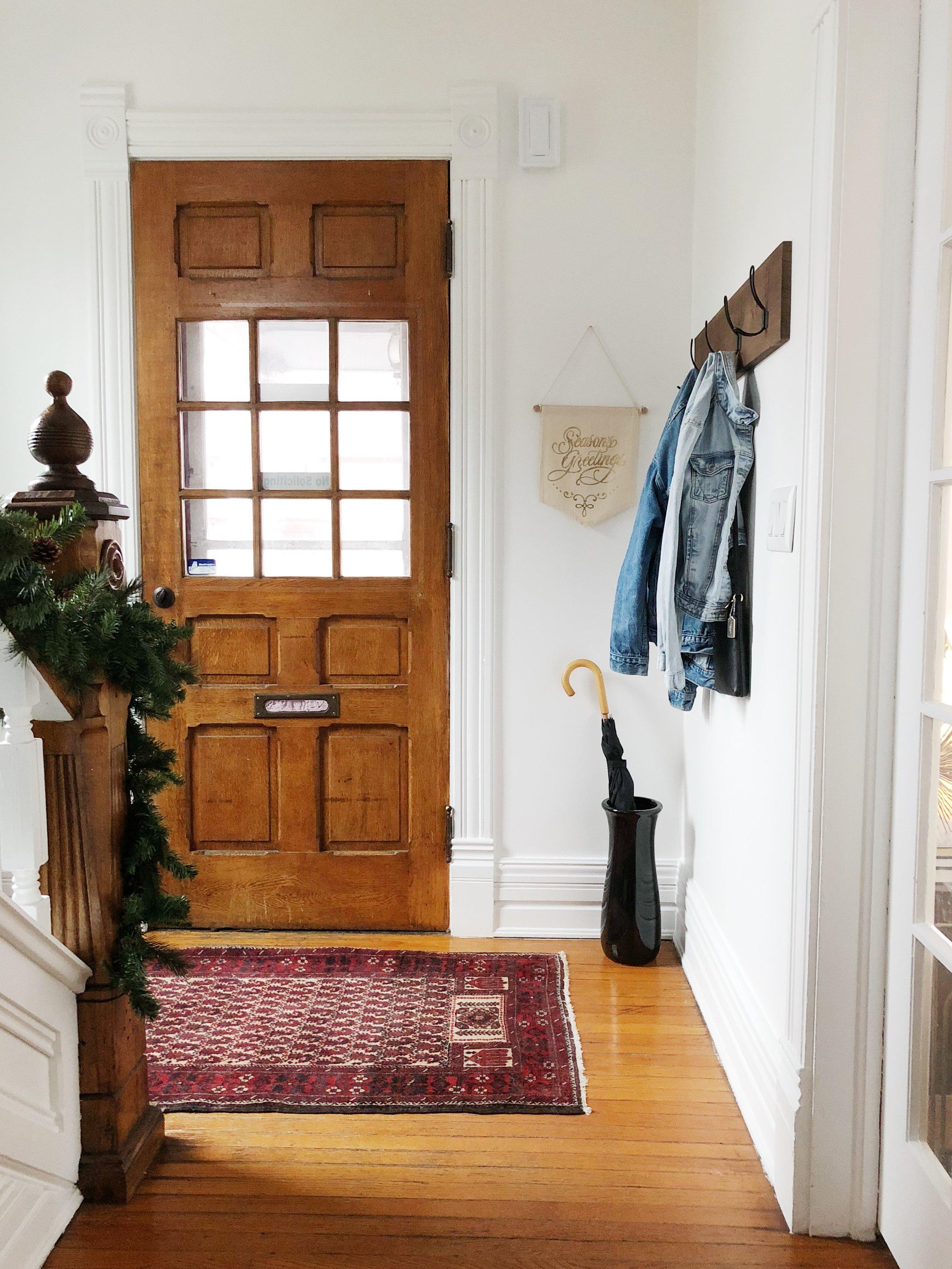 Holiday Entryway Season Greetings Wood Front Door Persian Rug Coat Rack