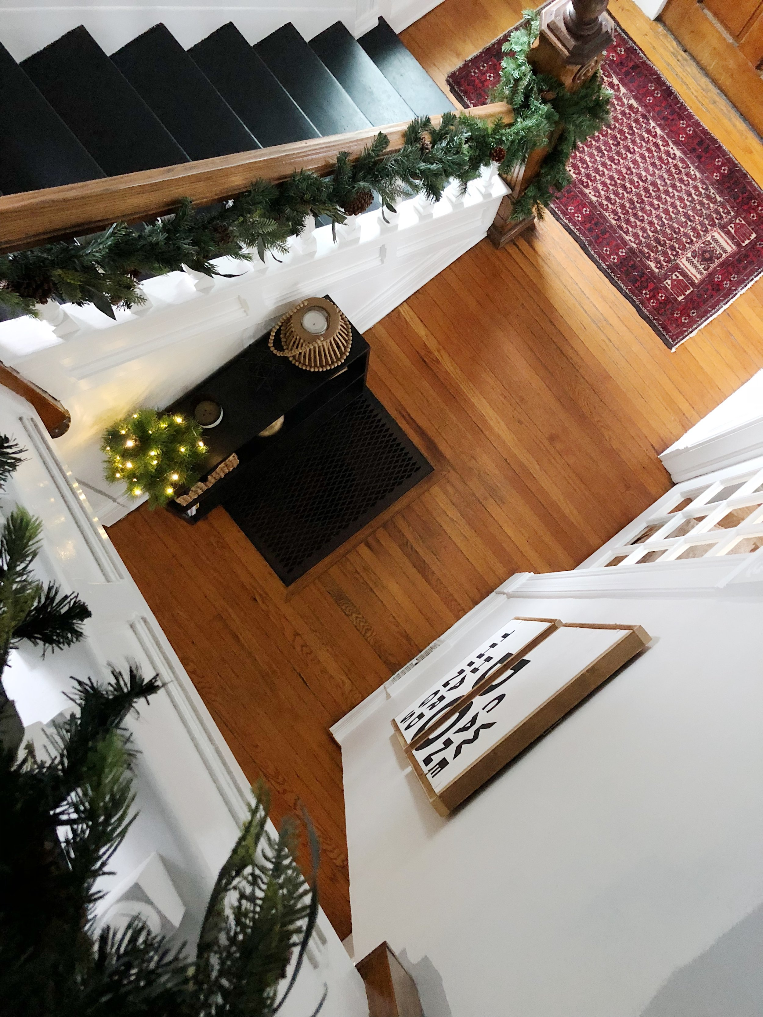 Black Painted Staircase Christmas Garland on Staircase Narrow Entryway Console Table Entryway Ideas