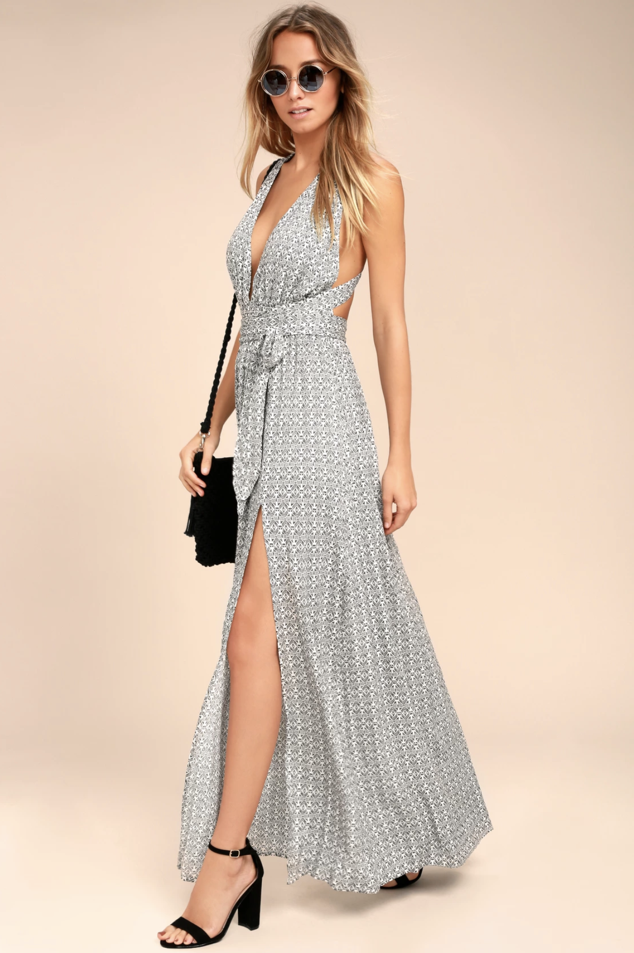 Make a statement in the Lulus Casablanca Queen Black and White Print Maxi Dress! Breezy, black and white print, woven rayon shapes a tying, halter neckline and plunging triangle bodice. Elasticized waist tops a flowy maxi skirt with sultry side slit.