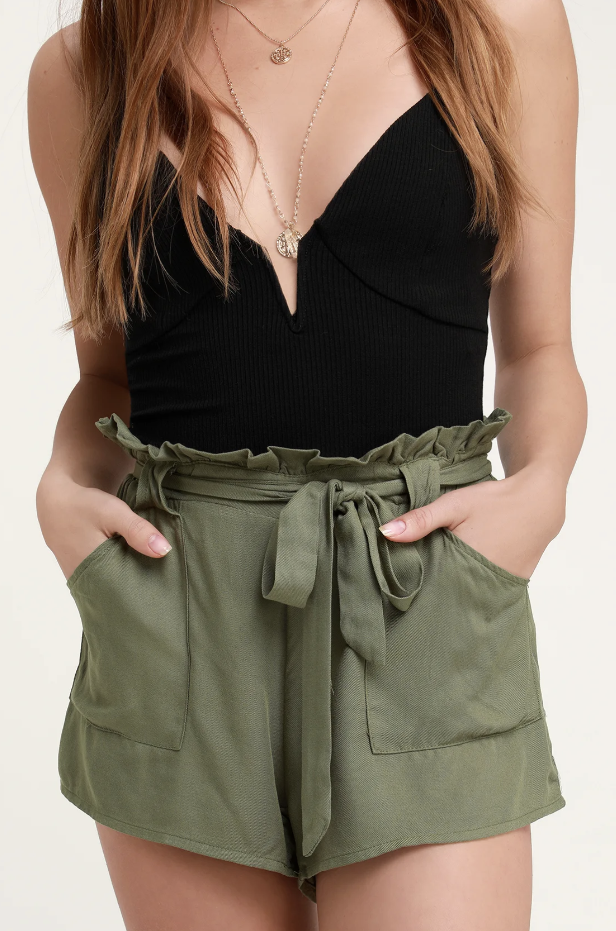 You will be warm-weather ready in your Jack by BB Dakota Belt It Out Olive Green Paper Bag Waist Shorts! Lightweight woven twill forms these vacation-ready shorts with a relaxed fit, cute high paper-bag waist and oversized utility pockets. Removable waist belt allows you to cinch the elasticized waist for a custom fit. Faux button pockets on back.