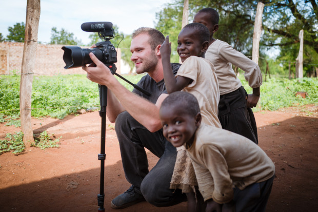 Marshal Chupa taking a photo in Africa while traveling for World Relief Canada