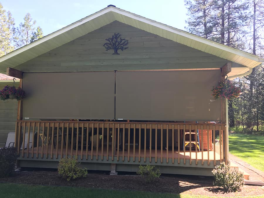 Insolroll Oasis 2600 exterior shades on covered deck in libby MT .JPG
